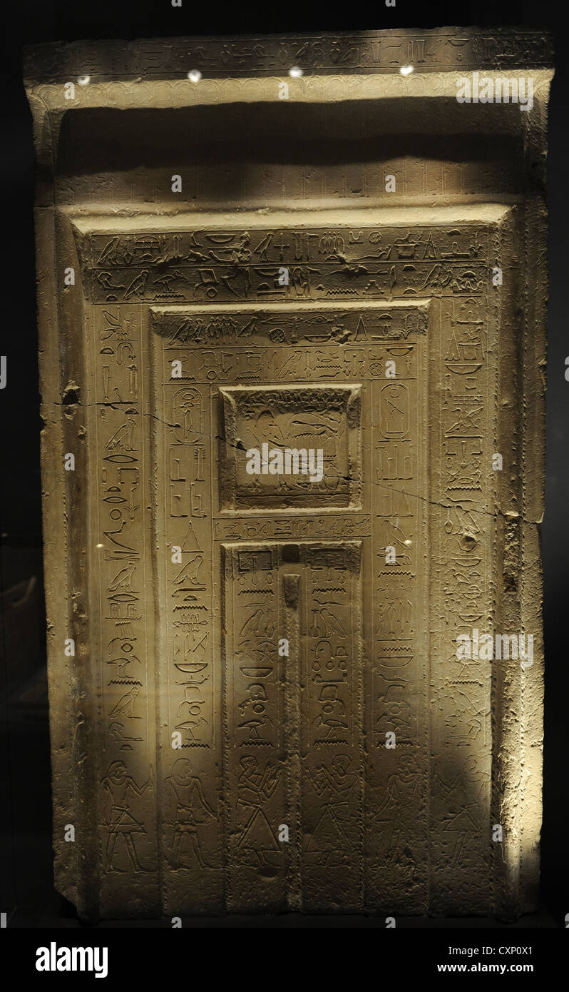 Egyptian Art. False-door of the Official Gemni-em-hat. Limestone. 11th-12th Dynasty. c 1990 BC. Middle Kingdom. - Stock Image