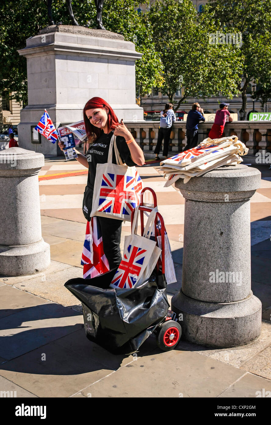Young promotions woman selling a daily newspaper in London - Stock Image