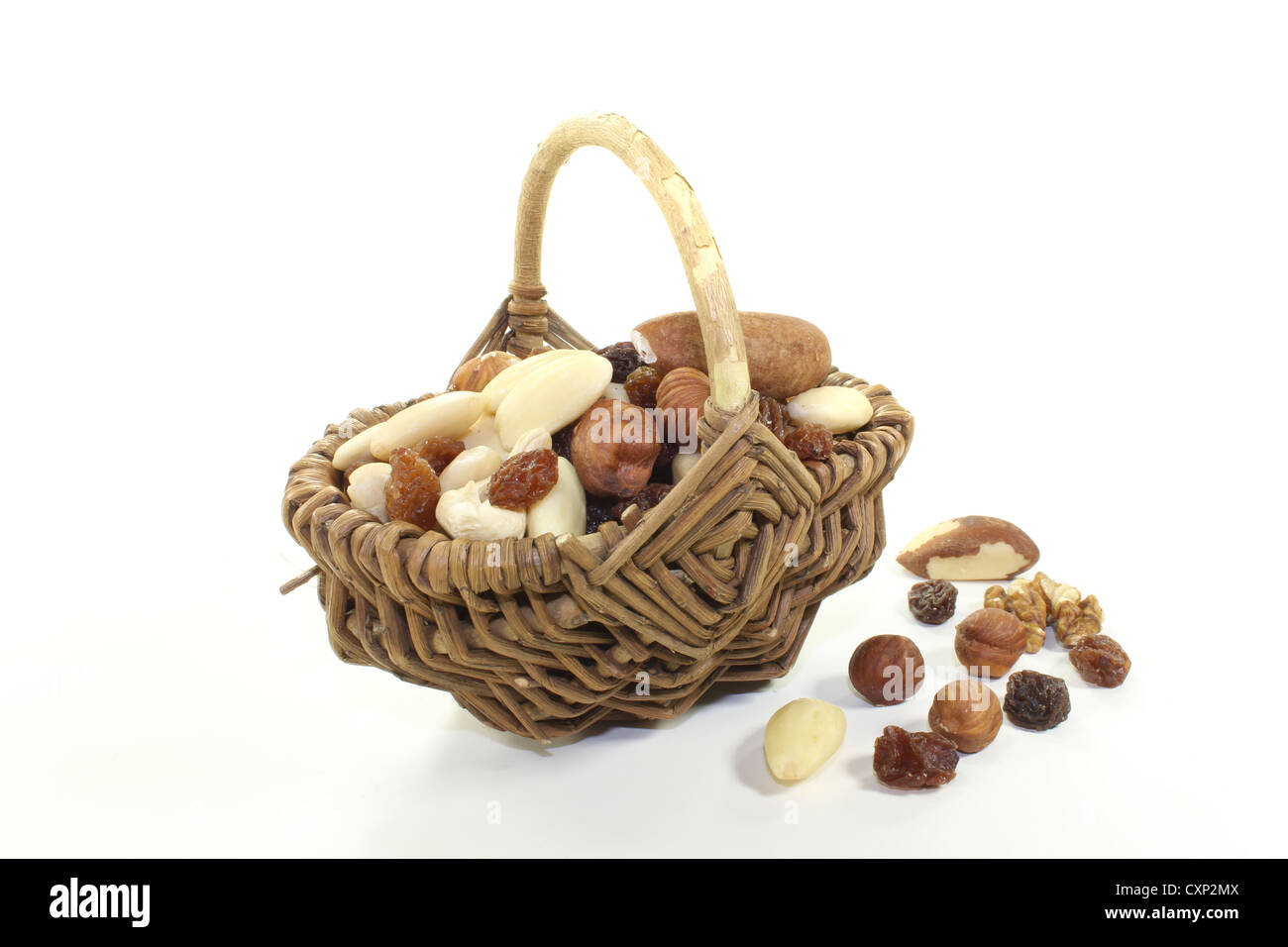 fresh mixed nuts and raisins as a snack on a bright background - Stock Image