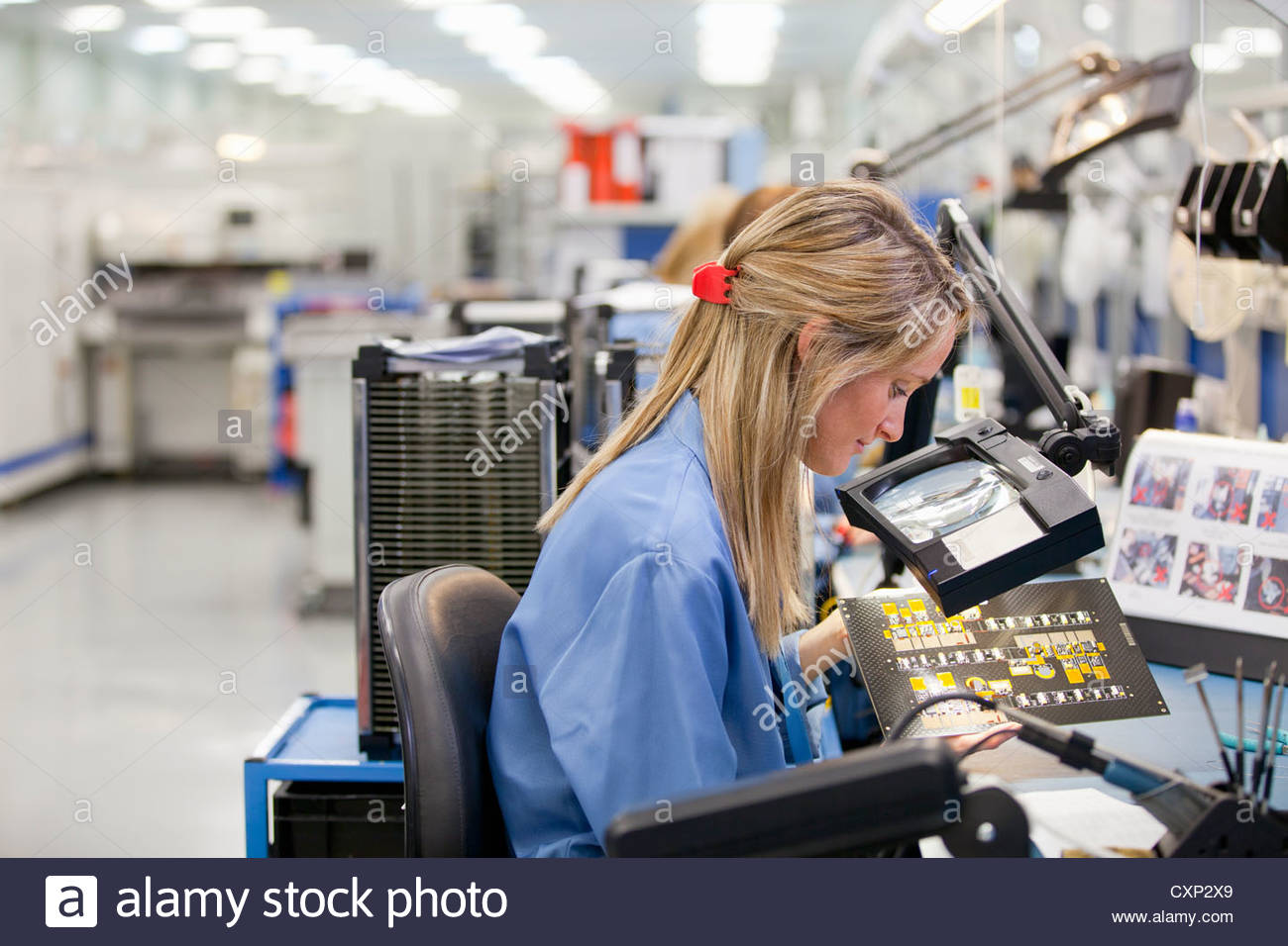 Printed Circuit Board Production Stock Photos Boardpcb Mass Product On Technician Examining In Hi Tech Electronics Manufacturing Plant Image