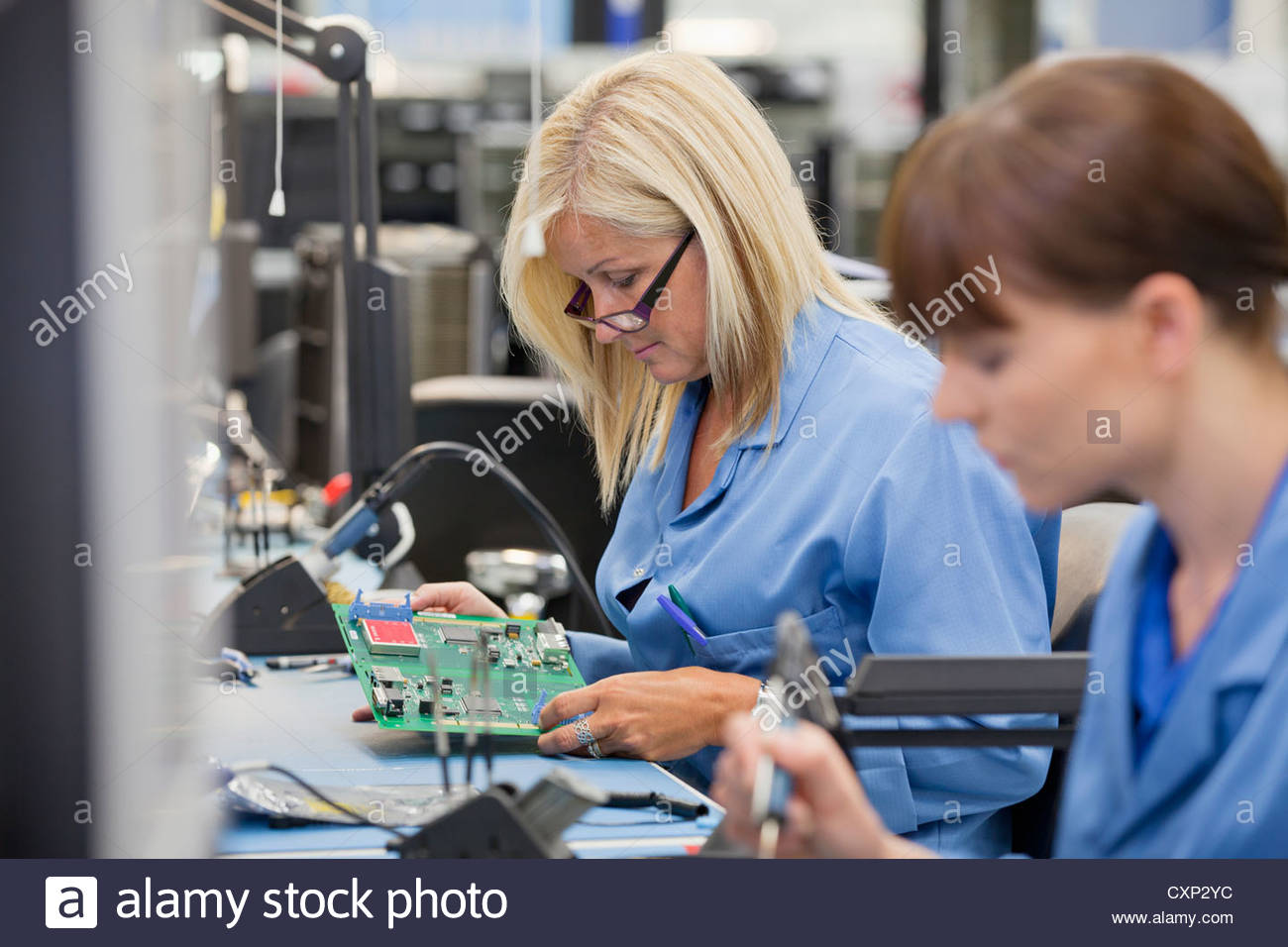 Circuit Boardpcb Mass Production Printed Board Product On Boards Stock Photos Technicians Examining In Hi Tech Electronics Manufacturing Plant Image