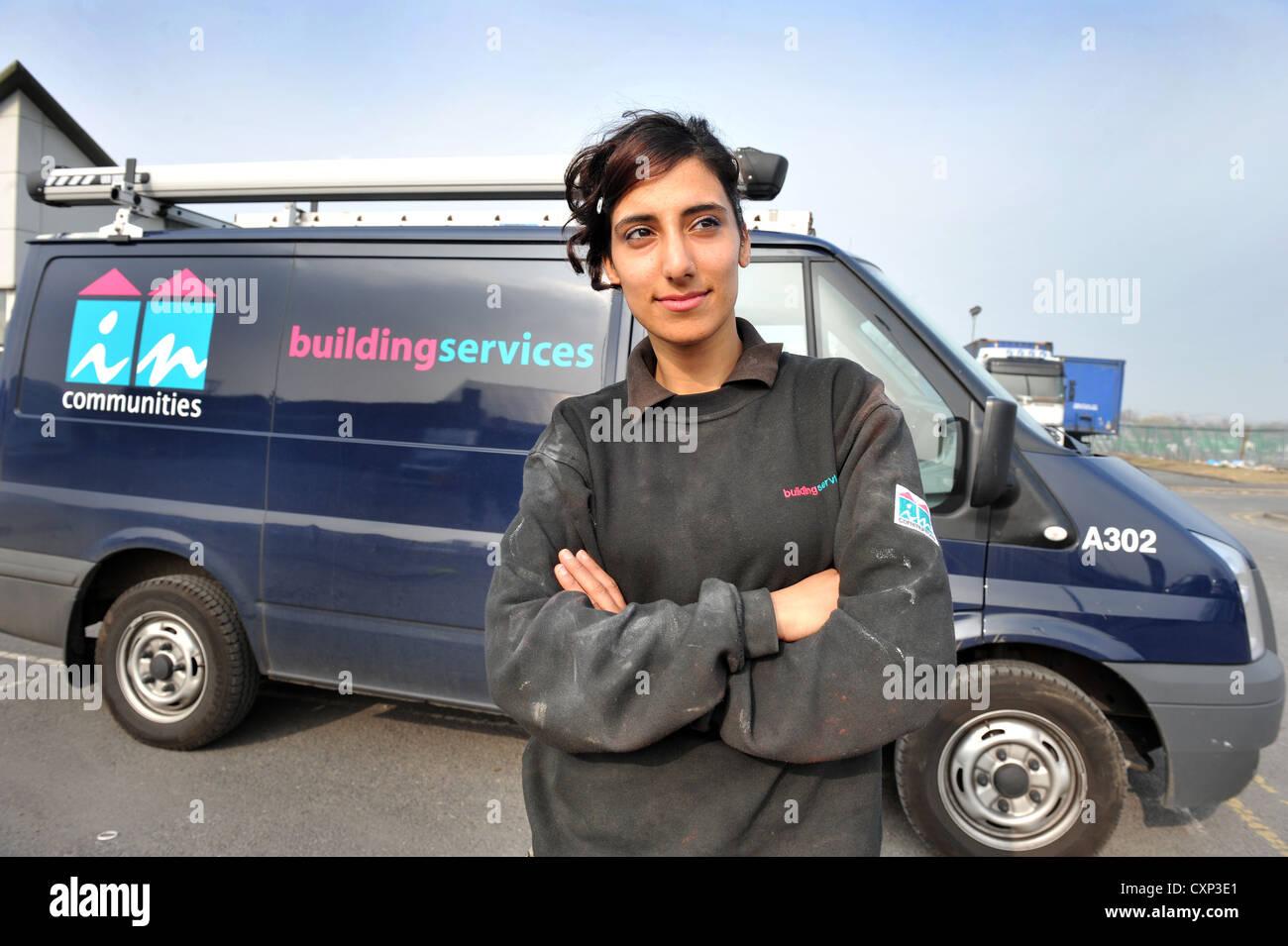 Portrait of a young plumbing apprentice in front of her work van. - Stock Image