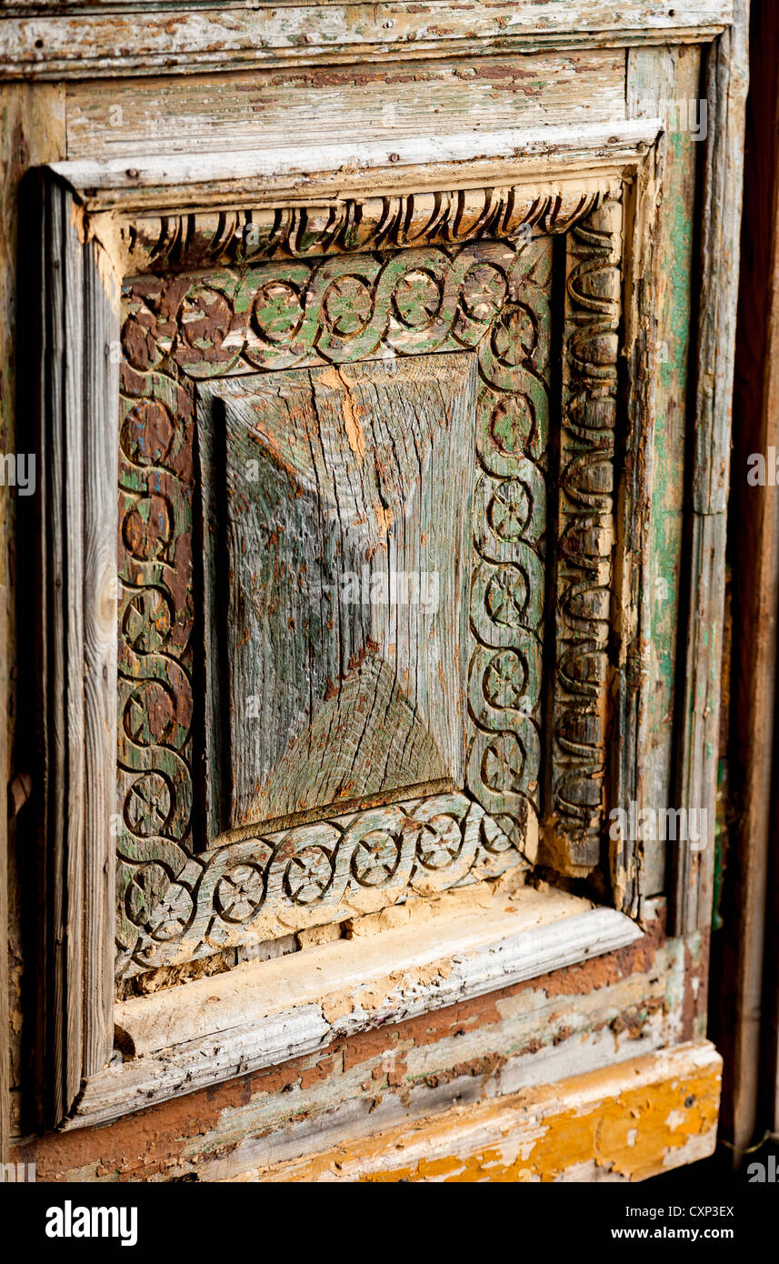 Old weathered door panel at the Schoolhouse on the Poland border country with the Czech Republic. - Stock Image