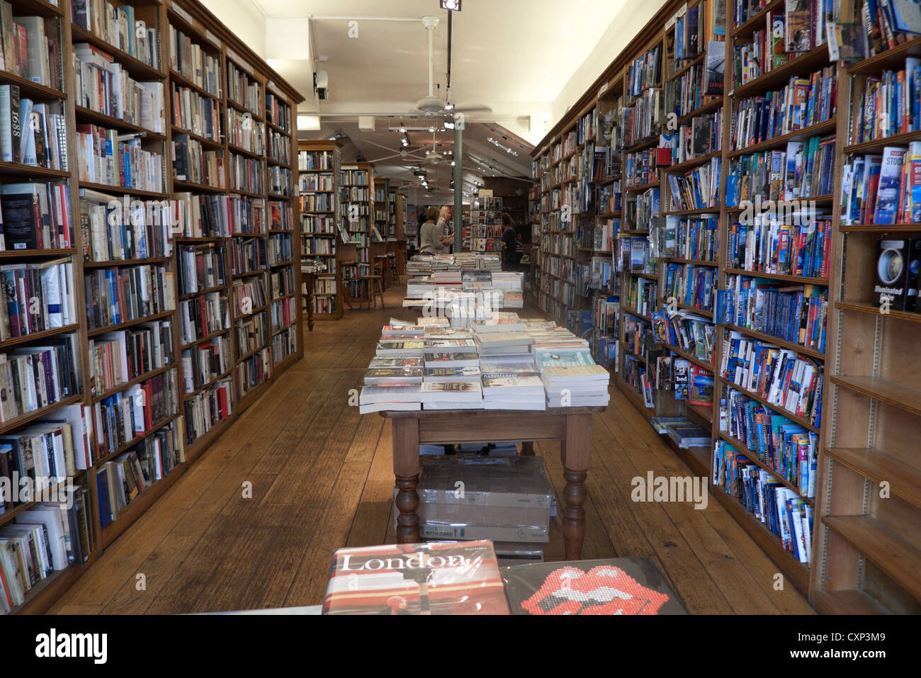 An inside view of books on book shelves atTopping & Co. Booksellers store in the City of Bath, Avon Somerset, - Stock Image