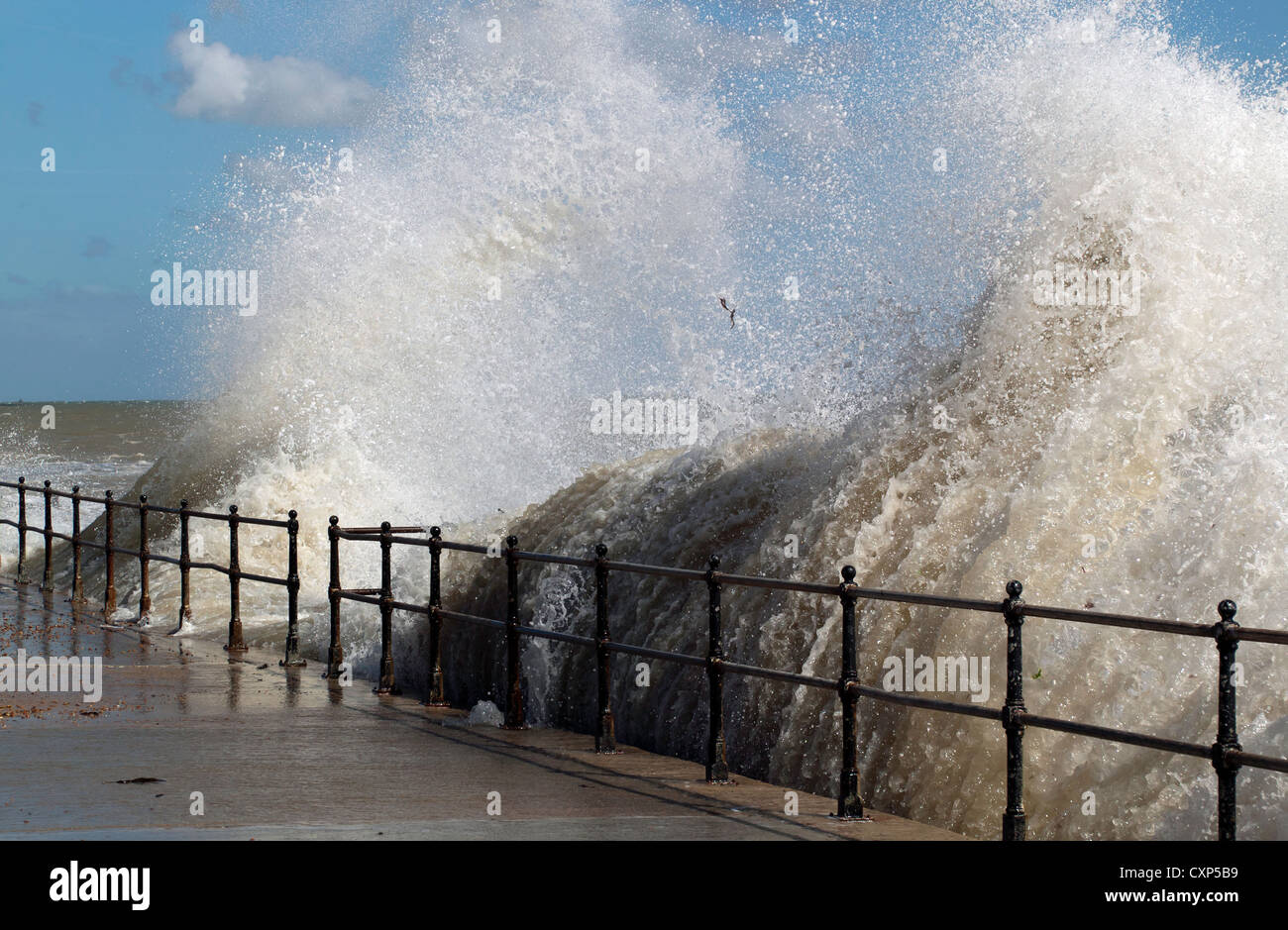 Dramatic waves sending up lagre plumes of sea spray as they crash against the sea wall at Kingsdown Kent on a windy - Stock Image