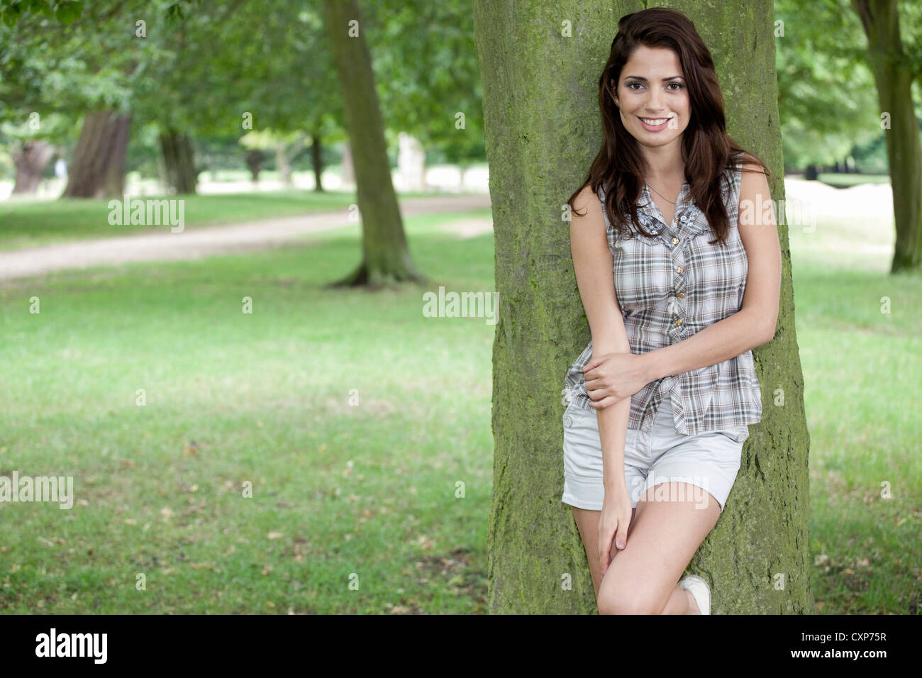 Woman in a park - Stock Image