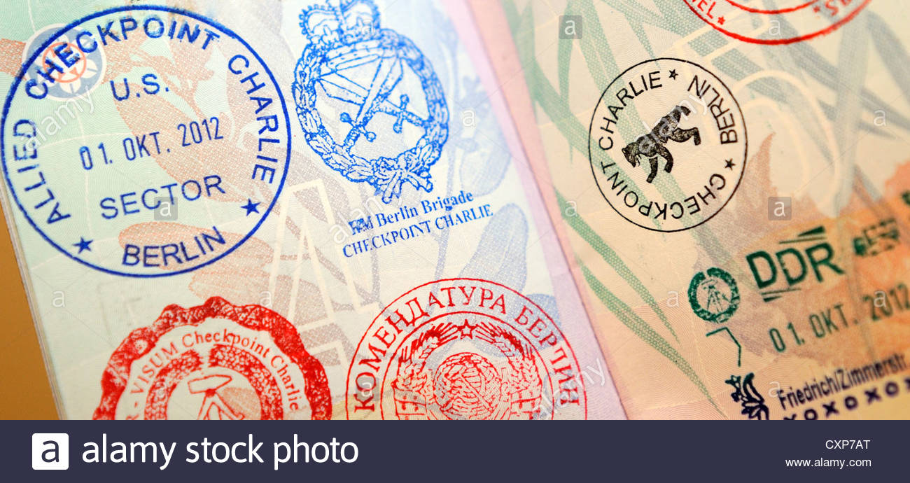 Checkpoint Charlie souvenir stamps in an Australian passport - Stock Image