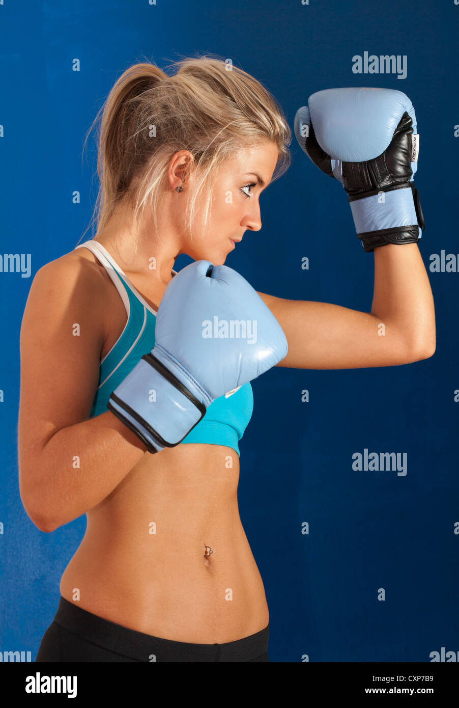 Woman boxing gloves - Stock Image