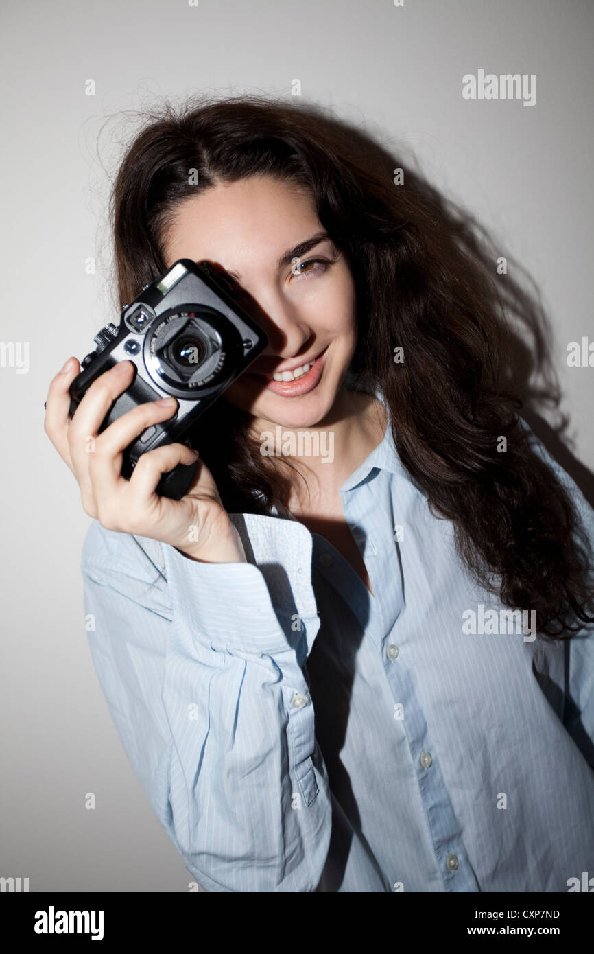 Young woman / teenager with camera - Stock Image