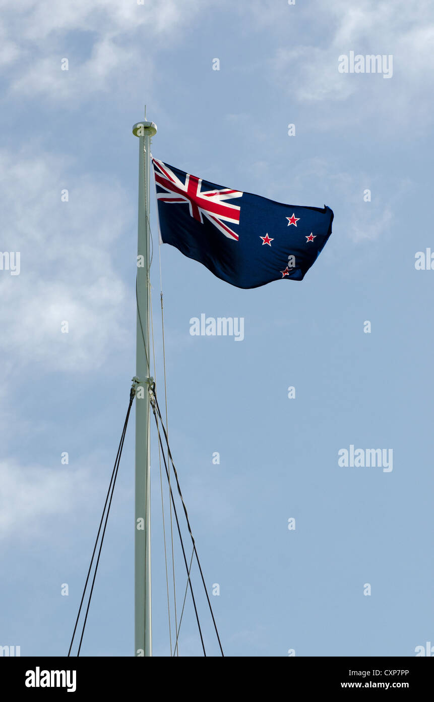 New Zealand national flag flying on a makeshift flagpole on a windy day. - Stock Image