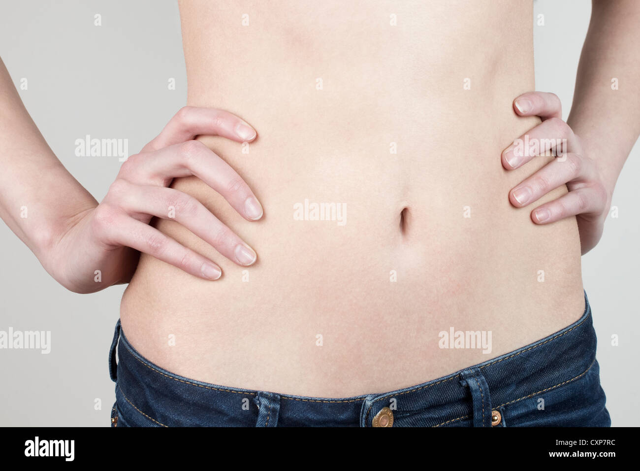 Woman's flat, thin stomach - Stock Image