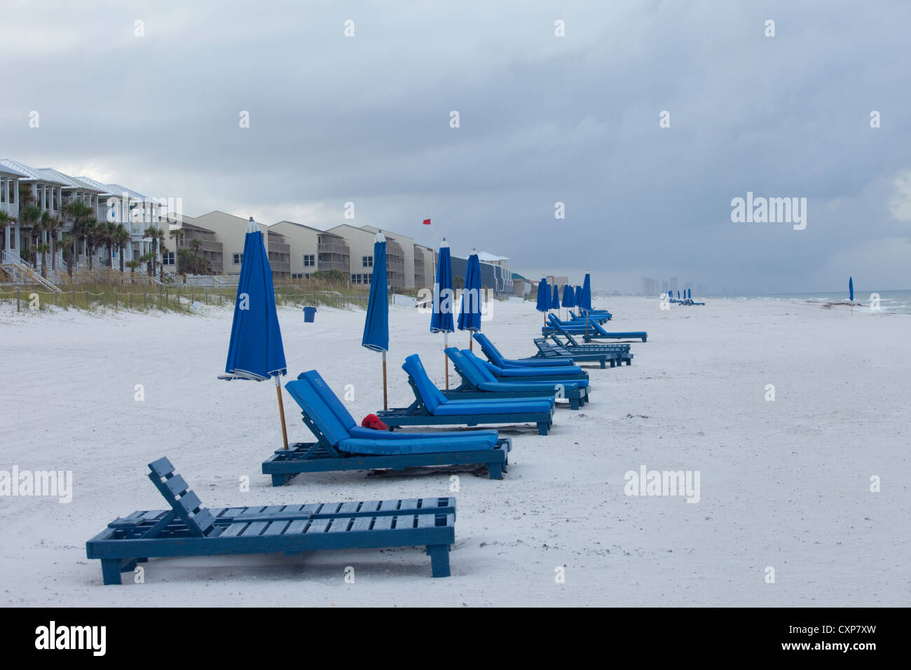 Beach chairs and umbrellas on a beach in the winter, Panama City, Florida - Stock Image