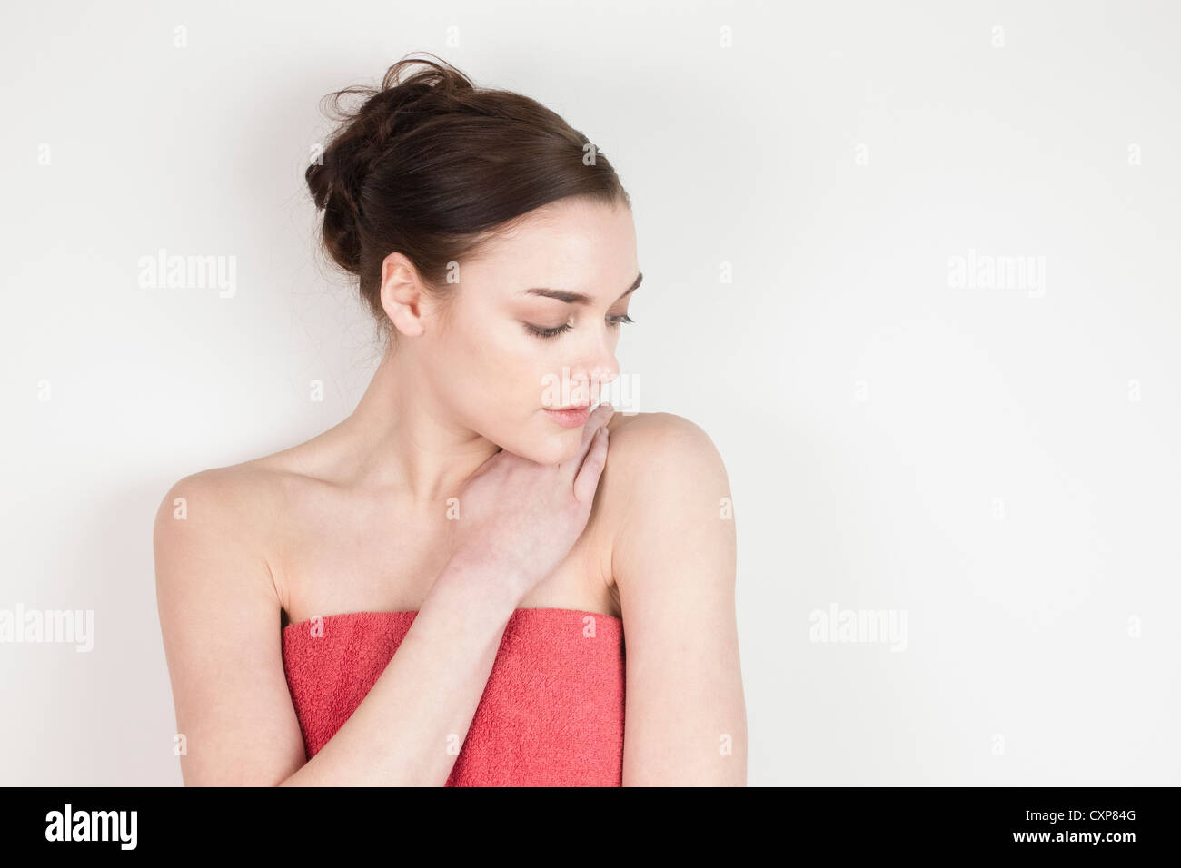 Woman wearing a bath towel - Stock Image