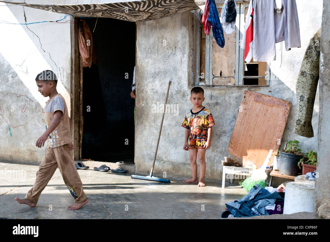 Syrian refugee children staying in a makeshift home in the Wadi Khaled region of northern Lebanon, along the Lebanese - Stock Image