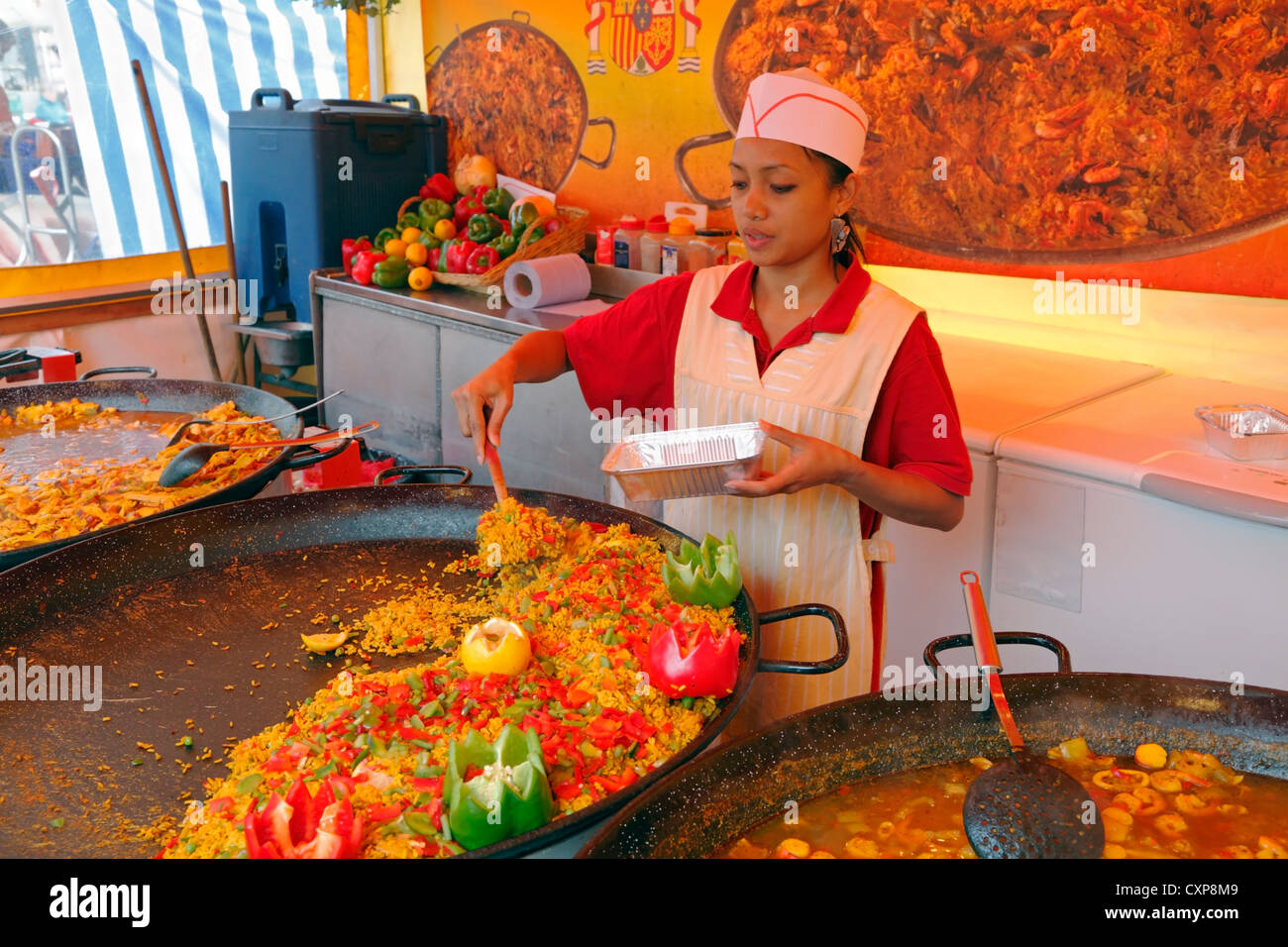 Spanish foods such as paellas and asopaos served from Spanish street kitchen or stall on Stroeget (Strøget), - Stock Image