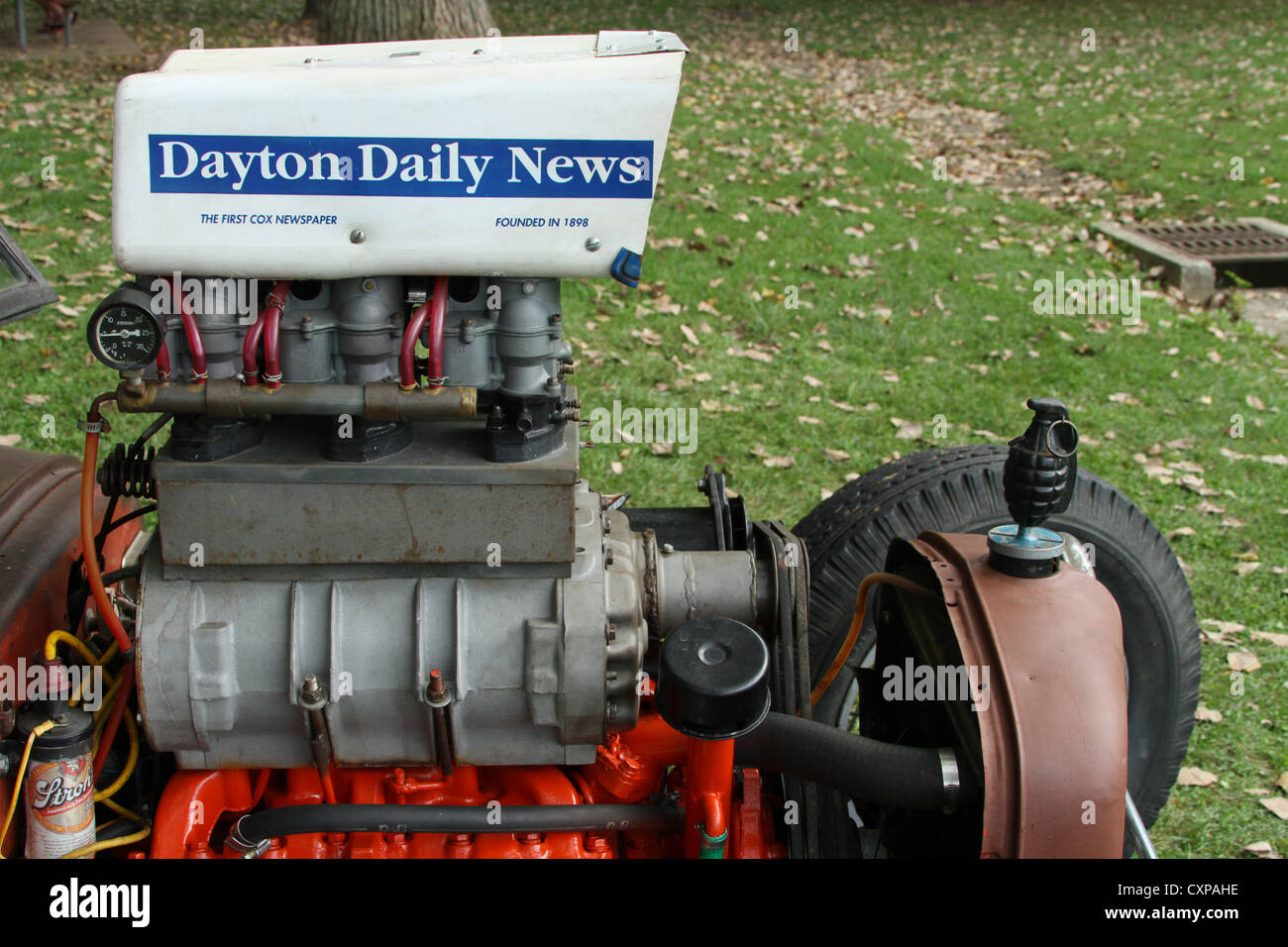 Rat Rod engine with a newspaper box as an air scoop. Dayton Daily News is the newspaper name. - Stock Image
