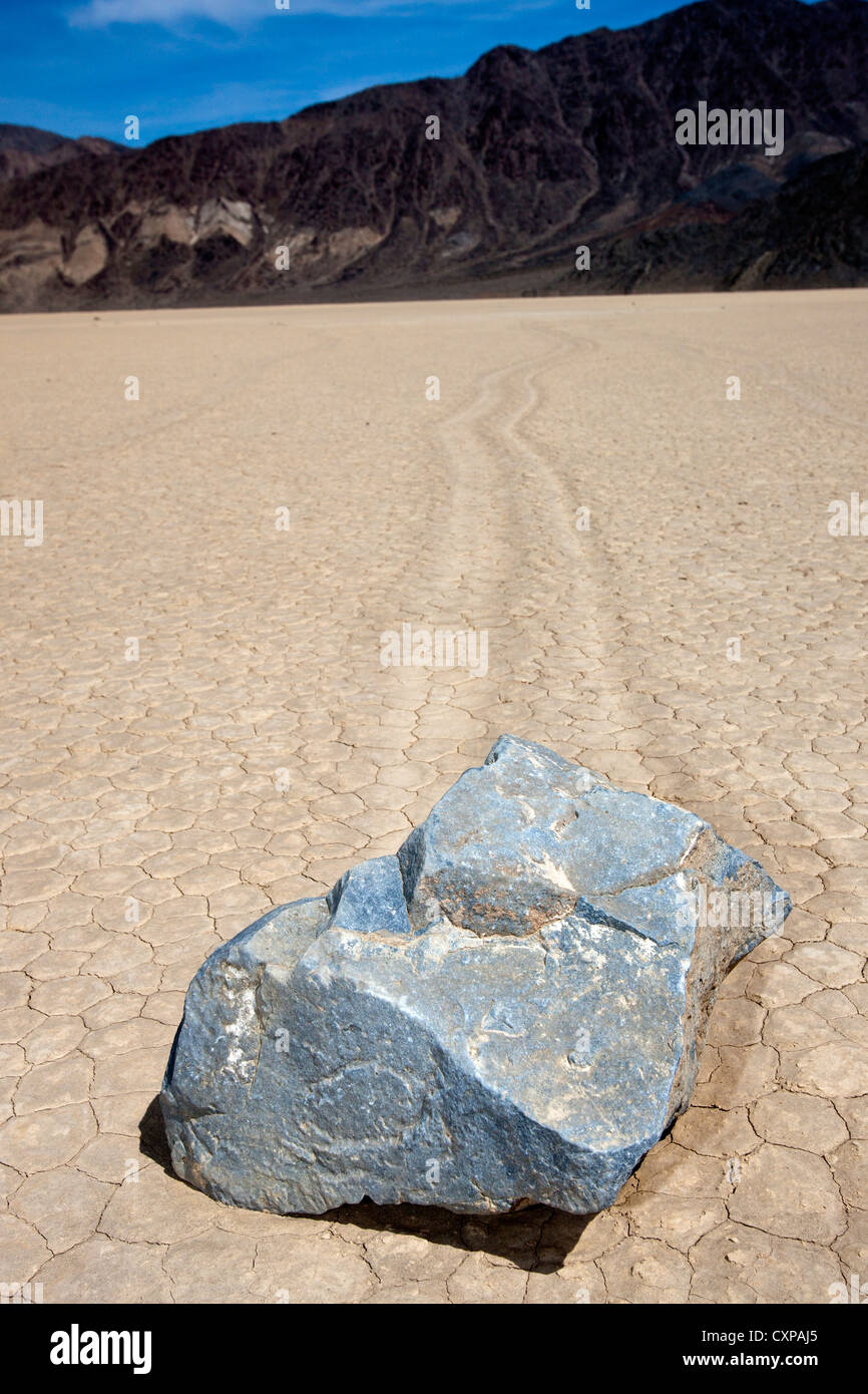 Moving rock on Racetrack Playa, Death Valley National Park, California, United States of America - Stock Image