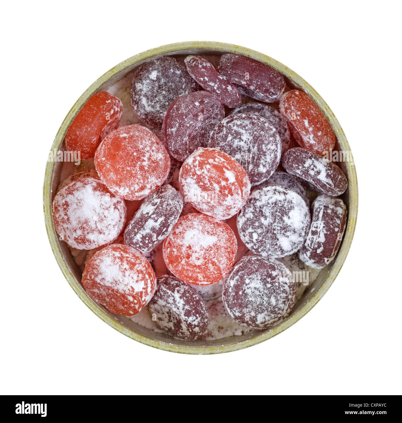A small tin filled with hard candy in fruit flavors dusted with powdered sugar. - Stock Image