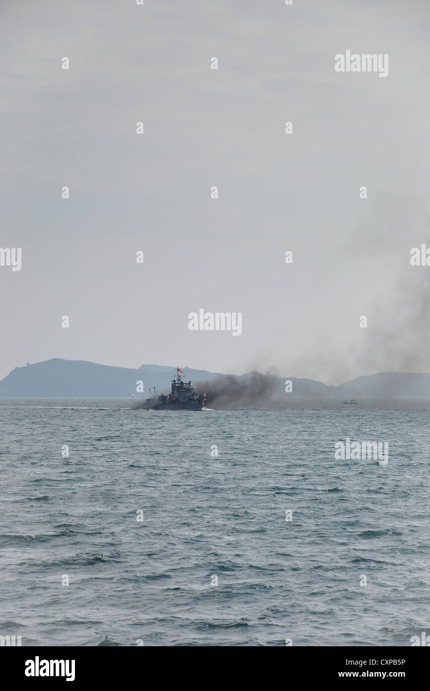 Military Boat Polluting the Air - Stock Image
