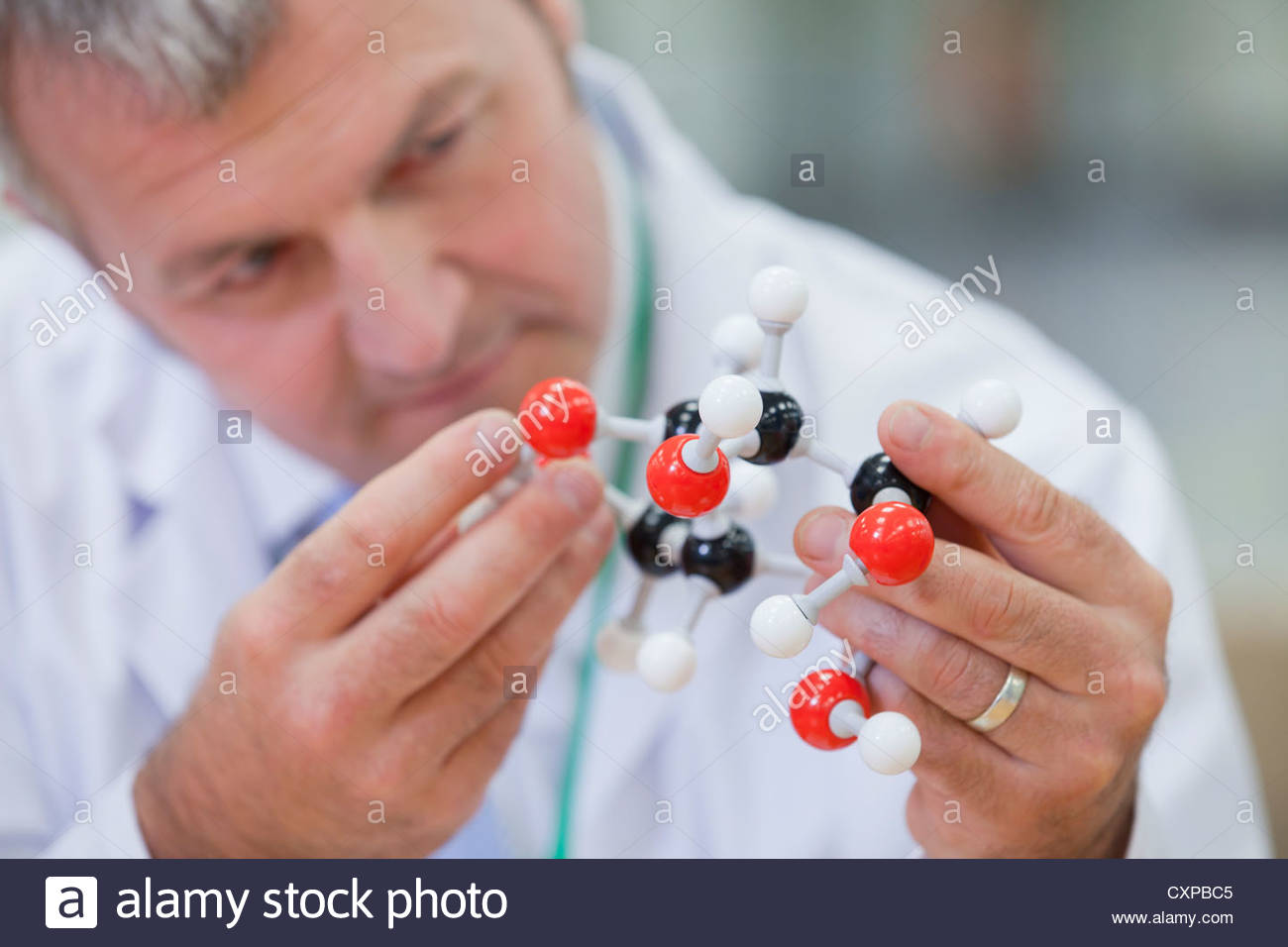 Close up of chemical engineer examining molecular structure - Stock Image