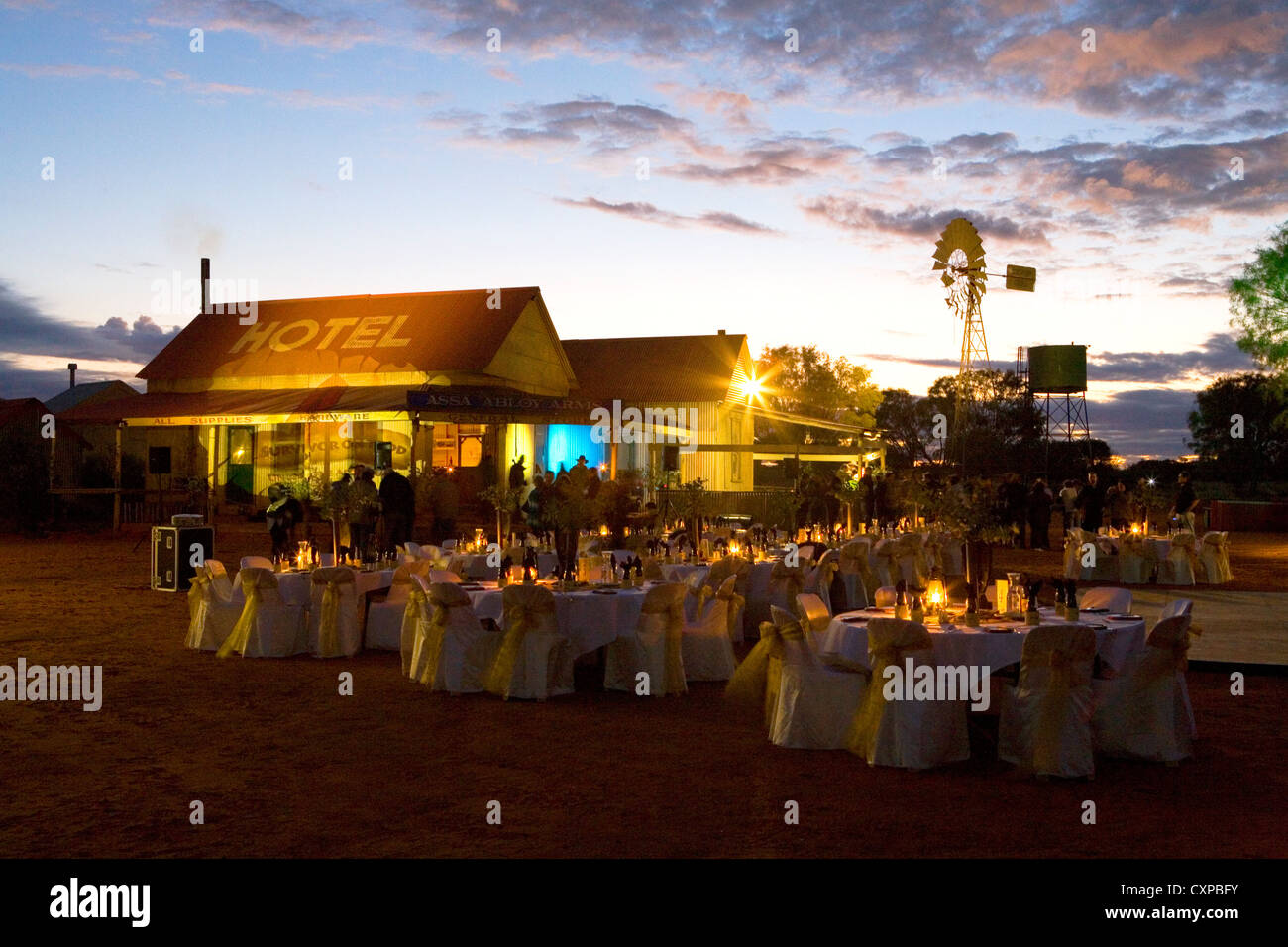 Corporate dinner in what was originally built as a movie set at Ooraminna Station outside Alice Springs, Australia - Stock Image