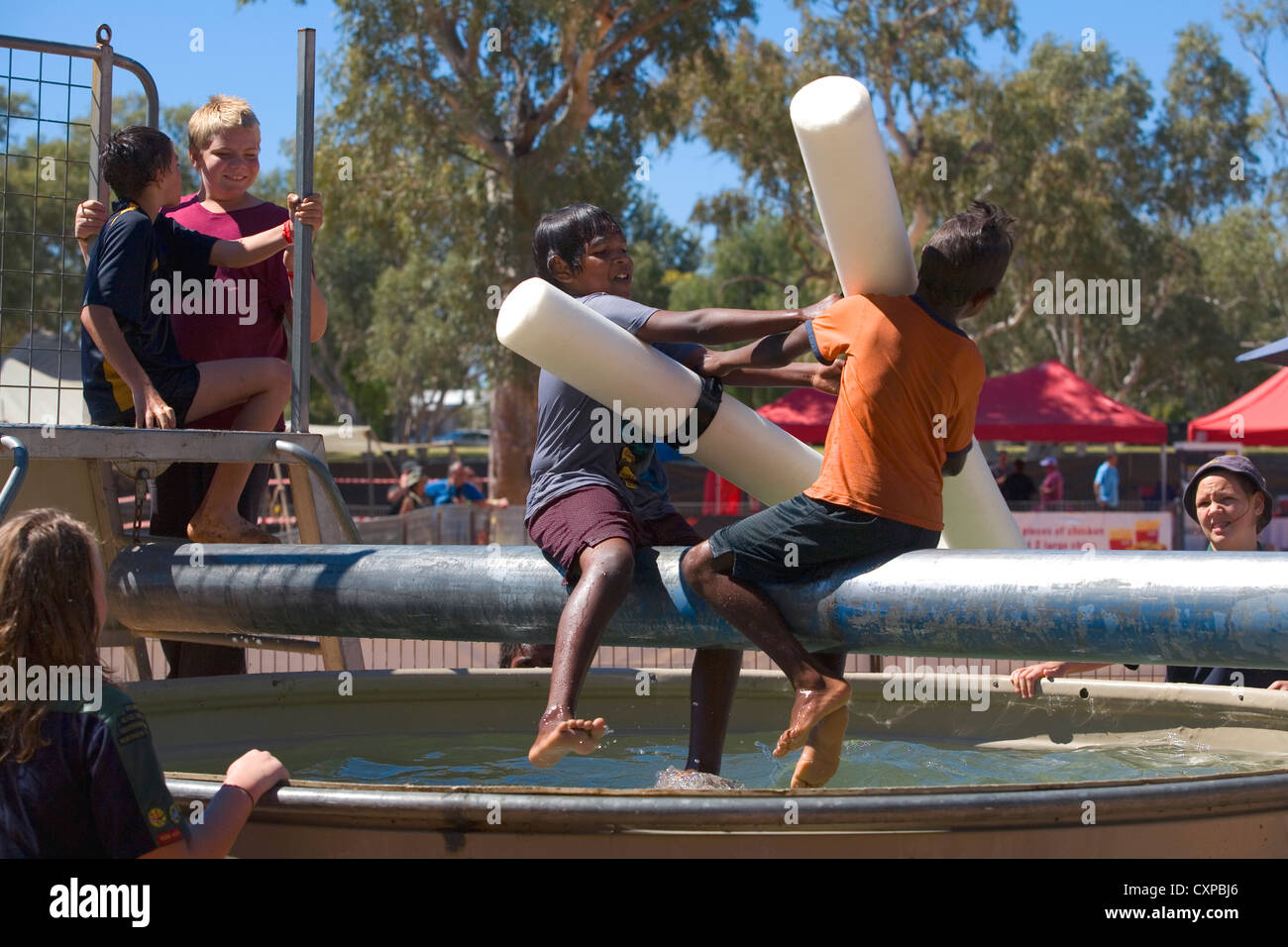Aboriginal children play in a pool at the 2010 Henley-on-Todd Regatta in Alice Springs, Australia - Stock Image