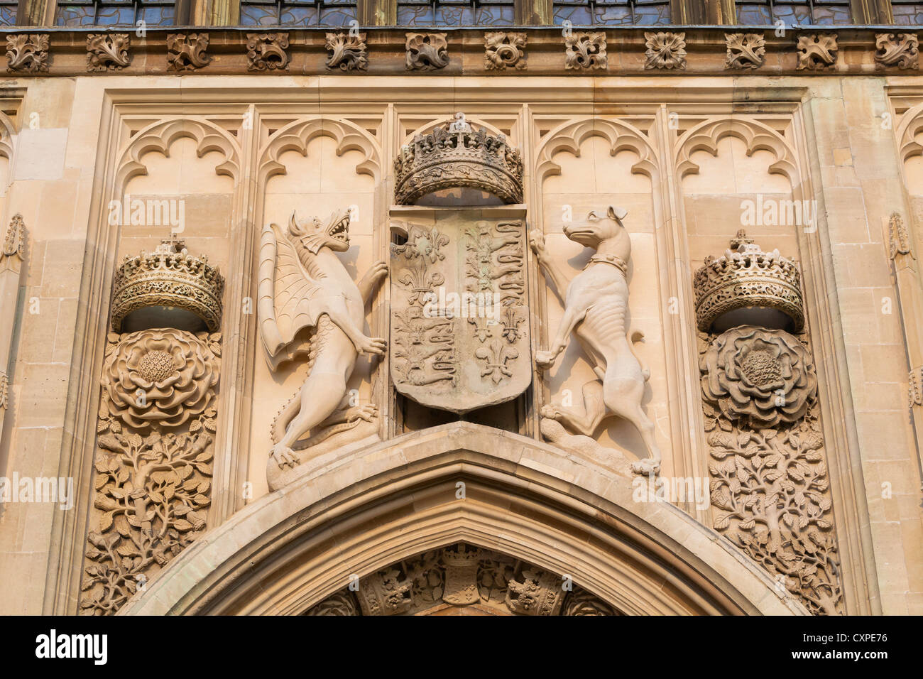 Detail of the emblems above the entrance to King's College Chapel, Cambridge, England - Stock Image