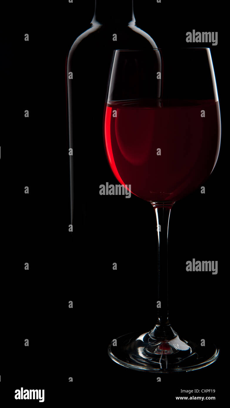 Colourful moody red wine and bottle depicting a quiet, subtle ambiance Stock Photo