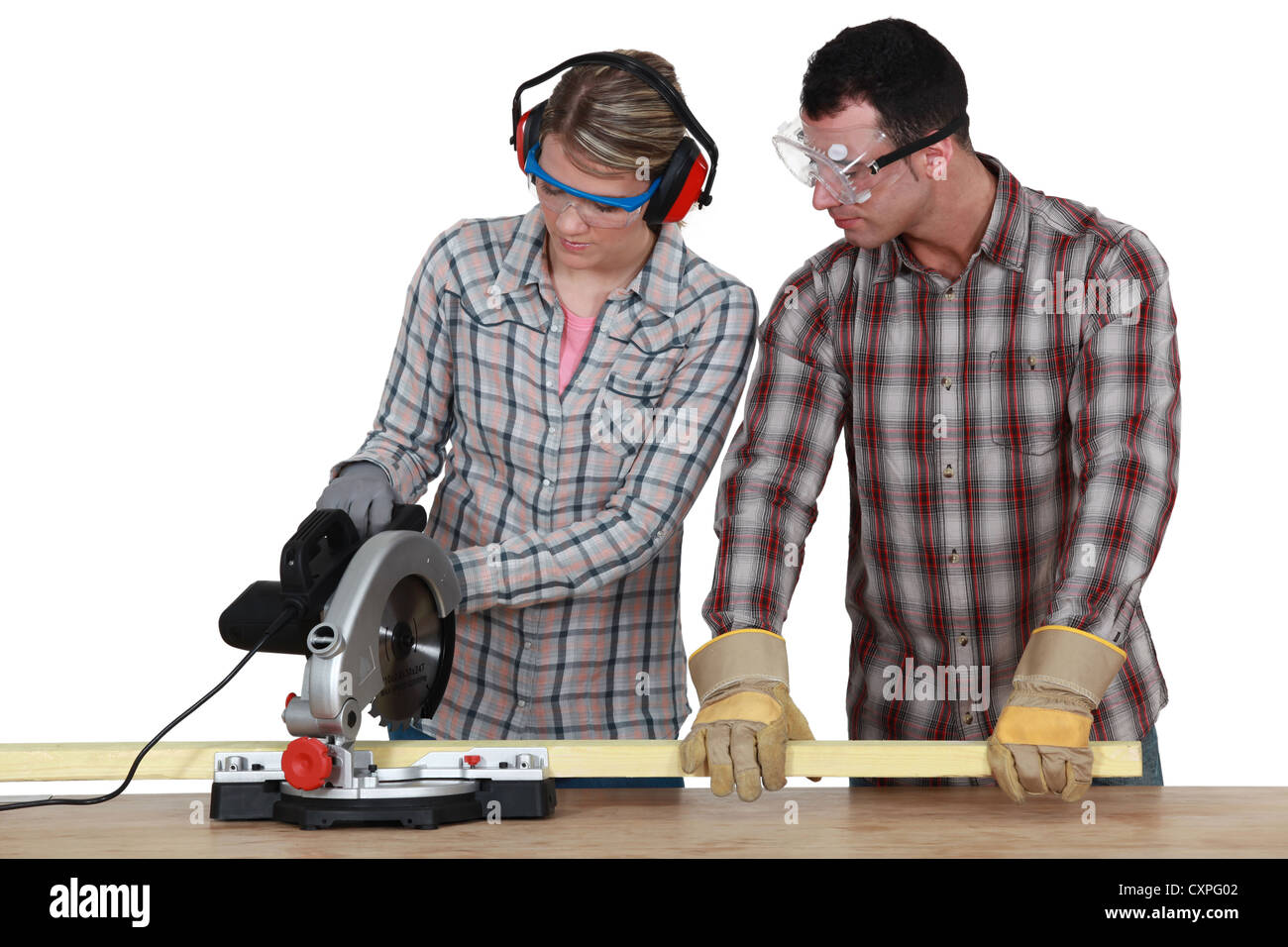Apprentice with circular saw - Stock Image
