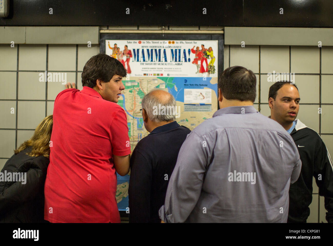 Subway Map New York Directions.Tourists Look At A New York City Subway Map For Directions Stock