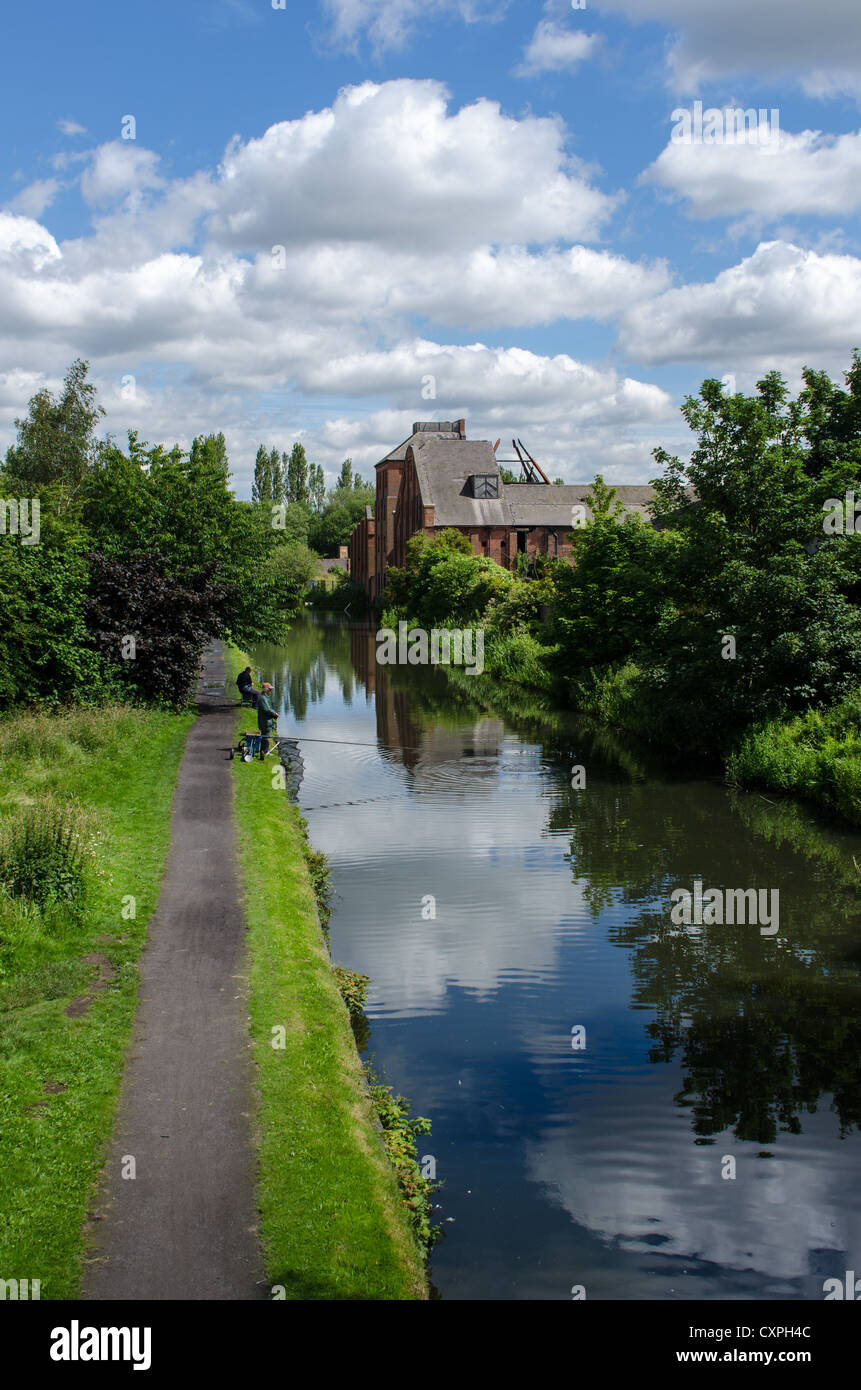 The fire-damaged remains of Langley Maltings viewed from the towpath of the Titford Canal in Langley, West Midlands - Stock Image