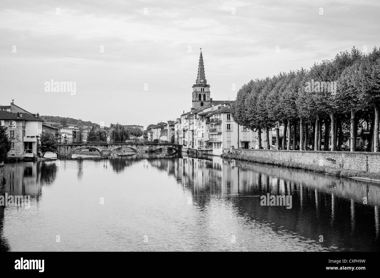 Black and white landscape view of St. Girons in the Midi-Pyrenees region of the South of France at dusk. - Stock Image