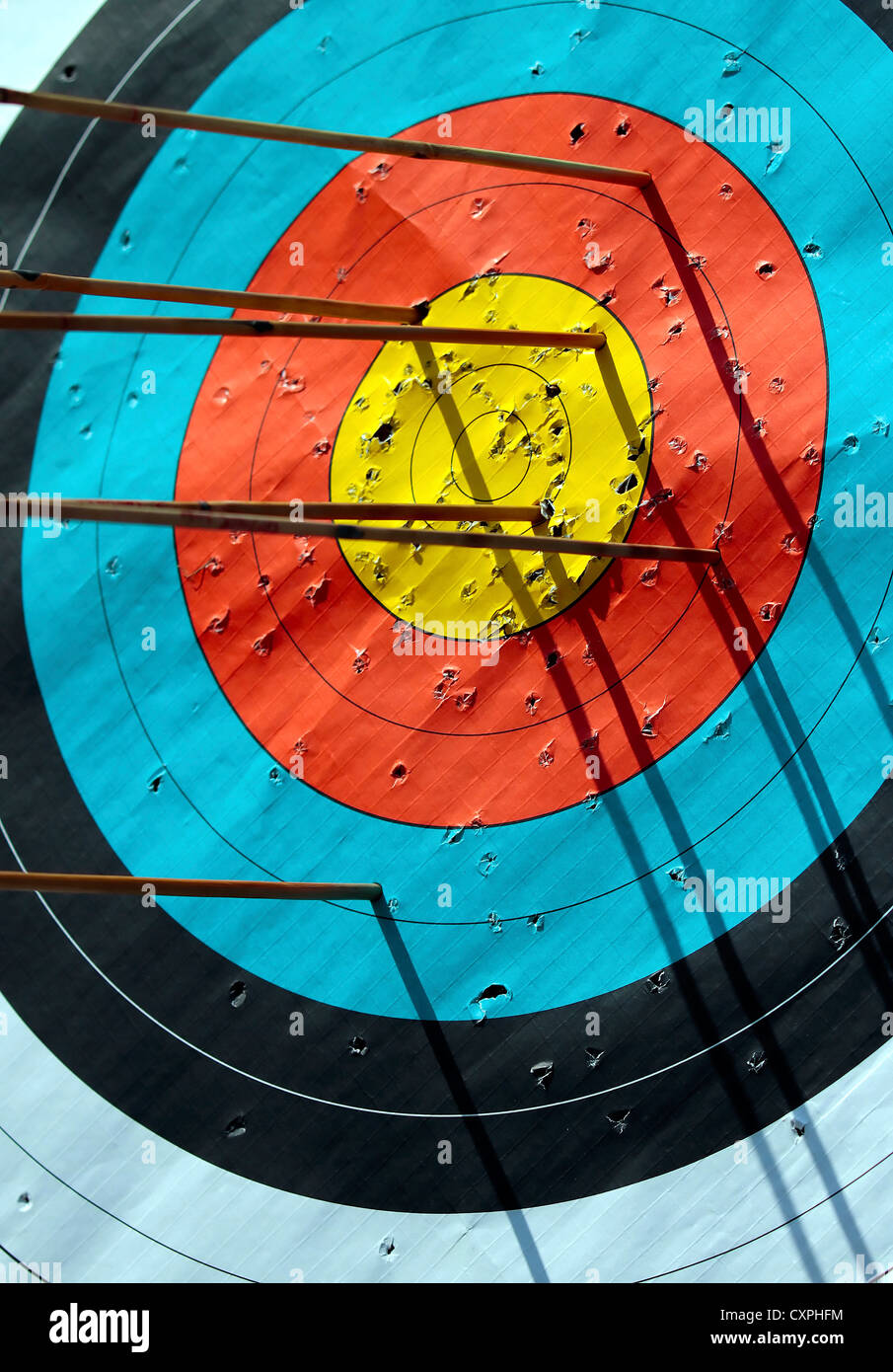 Target,Circle,Arrow,Archery,Descriptive color,Concepts,Competition,Target shooting,Target,Shoot,Bull eye,Sport,Focus Stock Photo