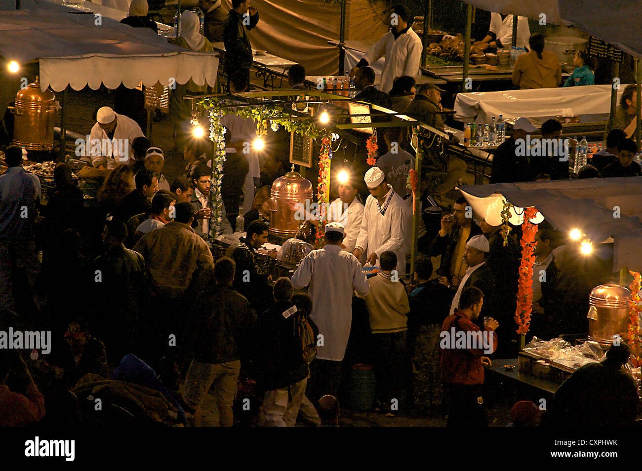North Africa, Morraco, Marrakech. Night time dining at outdoor restaurants on Jemaa el-Fnaa Square. Stock Photo