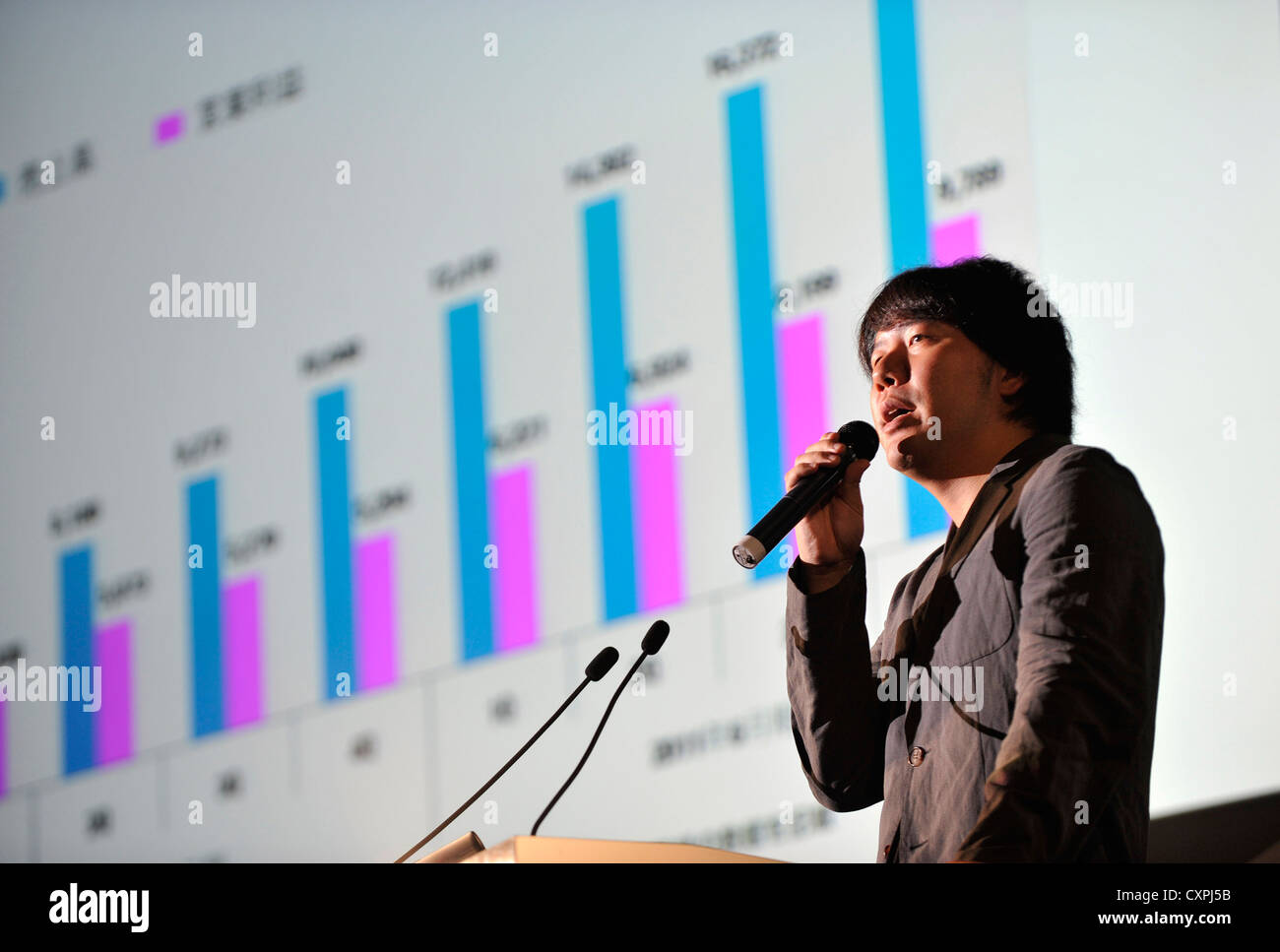 Yoshikazu Tanaka, president of social networking service Gree Inc., delivers a keynote speech at the Tokyo Game - Stock Image
