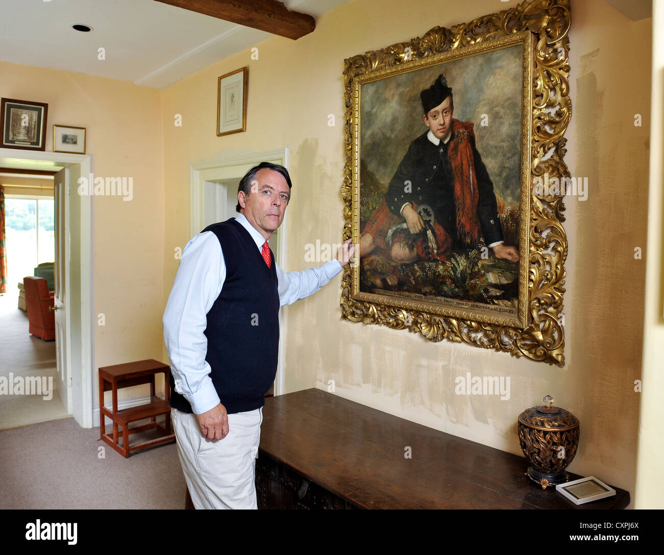 David Brudenell-Bruce Earl of Cardigan pictured with a painting of his Great Grandfather Chandos 6th Marquess of - Stock Image