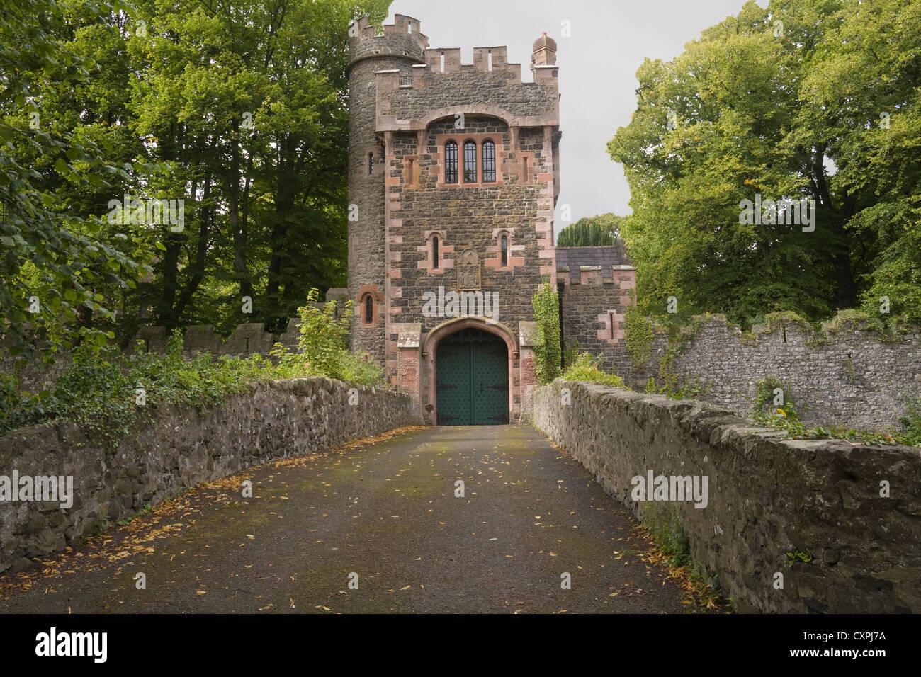 Glenarm Co Antrim Northern Ireland Castle gateway in appealing small village one of oldest glen settlements - Stock Image