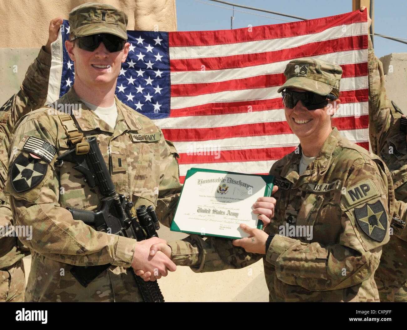 Staff Sgt. Rebecca Osborn, a military police soldier from Daggett, Mich., appears after reenlisting in the Army - Stock Image
