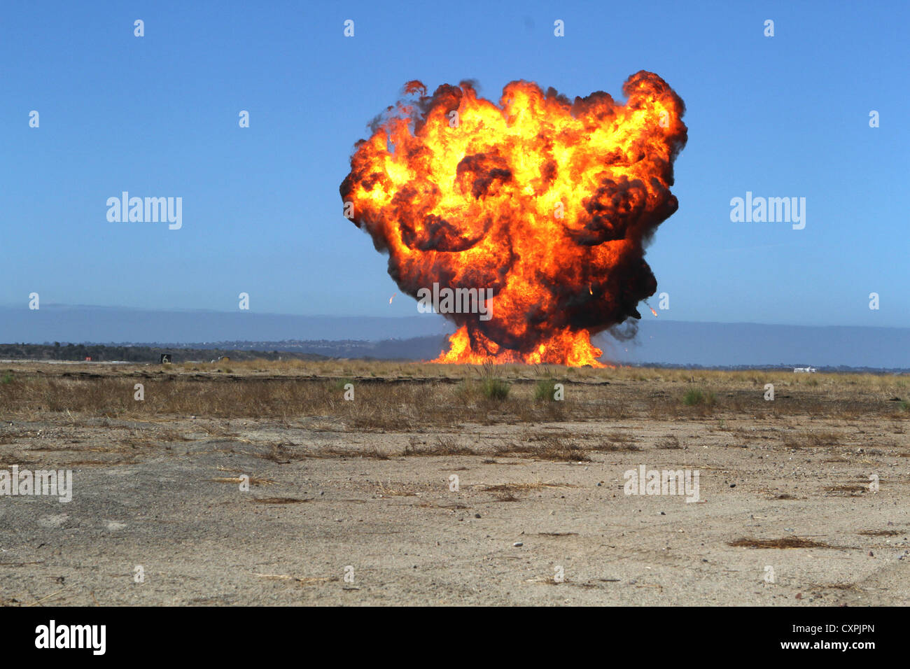 An explosive goes off on the flight line during a simulated napalm explosion aboard Marine Corps Air Station Miramar, - Stock Image
