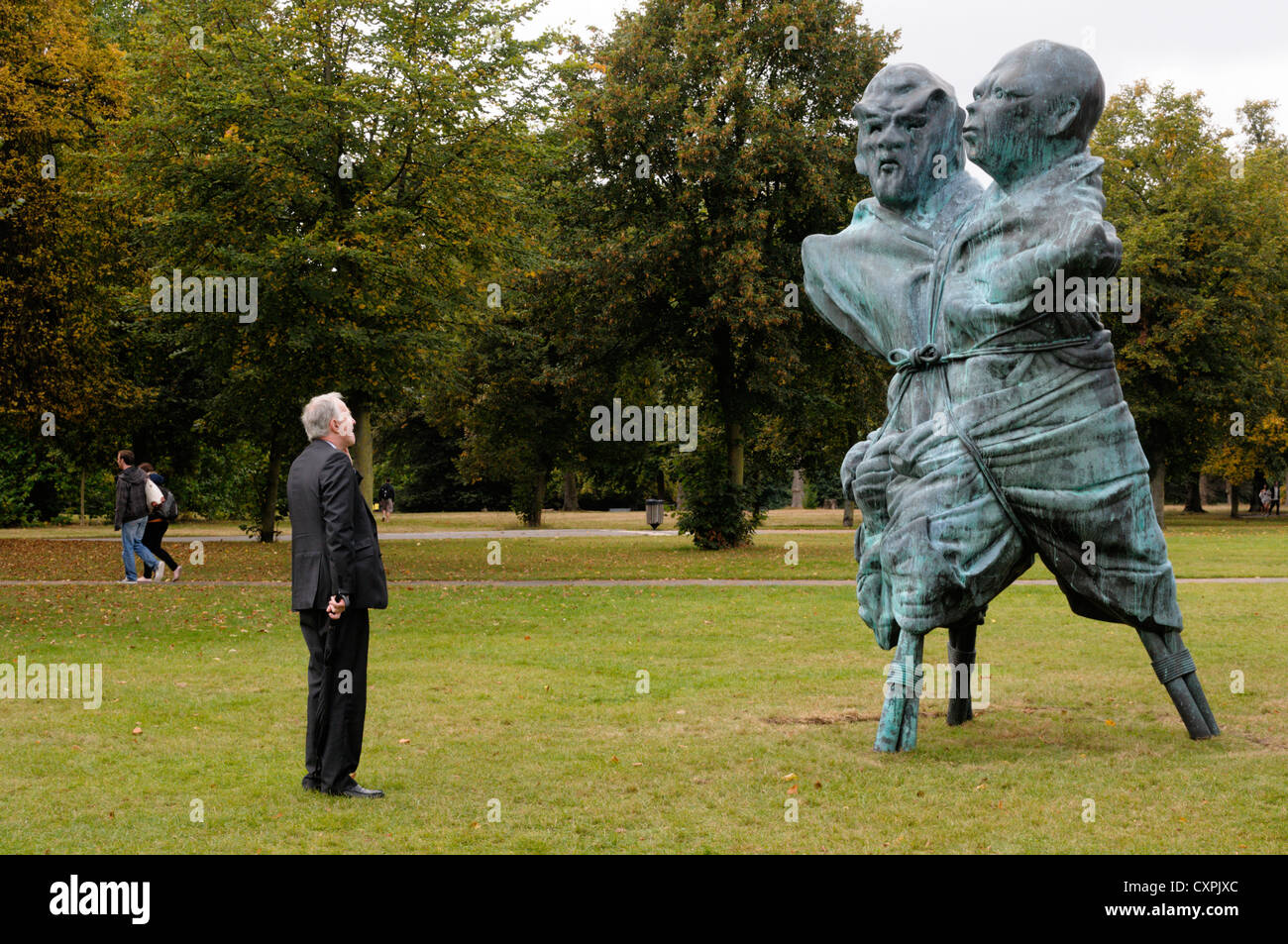 Thomas Schütte's United Enemies in Kensington Gardens outside the Serpentine Gallery, London. Stock Photo