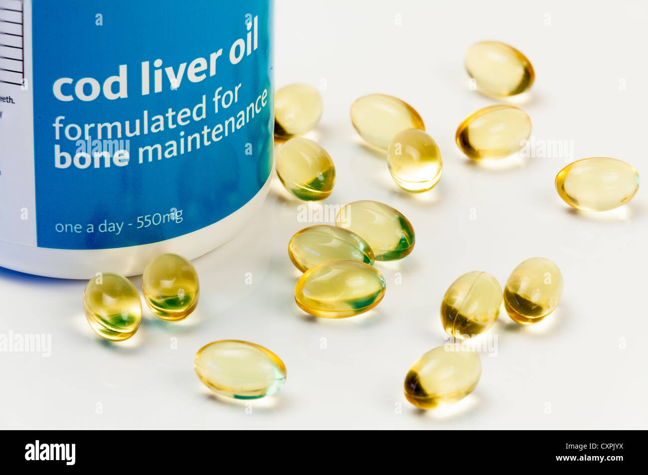 Close up studio still life of cod liver oil Capsules and container. - Stock Image