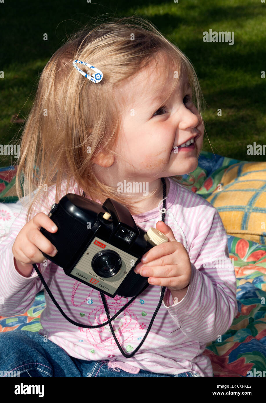 Young girl playing with Kodak Brownie camera. - Stock Image