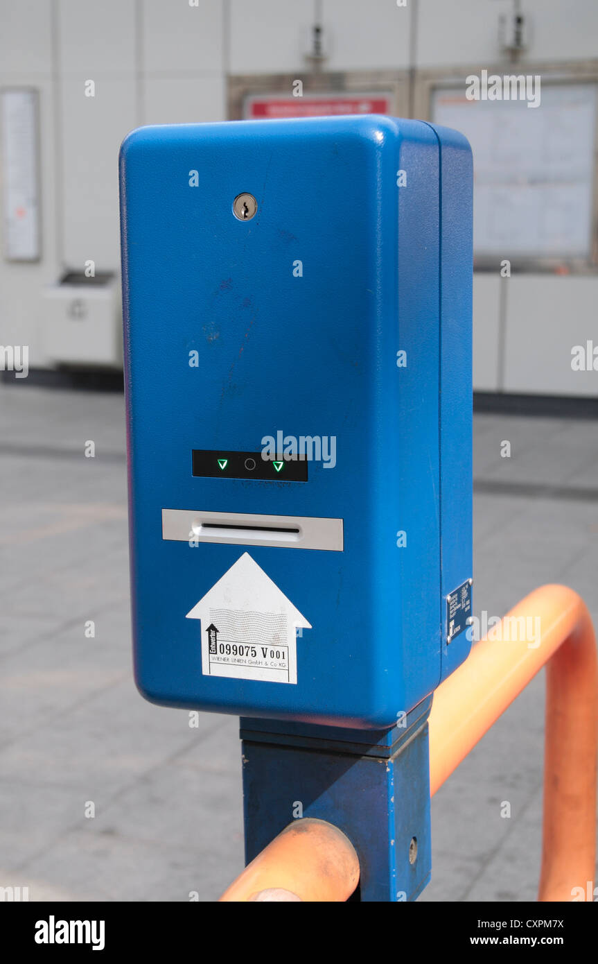 A blue bus ticket validation machine at the entrance to a U-Bahn metro railway station in Vienna (Wien), Austria. - Stock Image