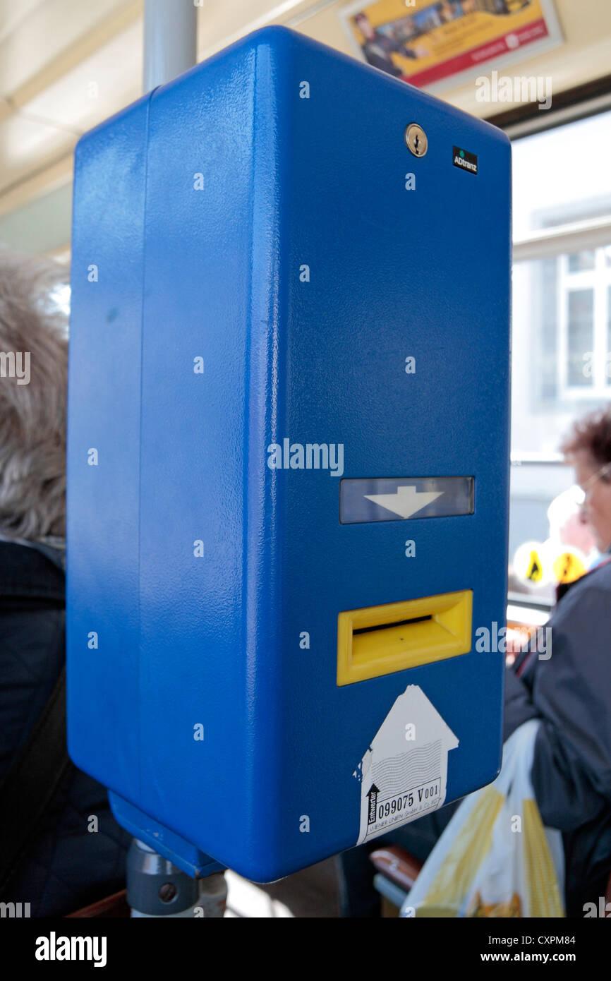 A blue bus ticket validation machine on an Austrian tram Vienna (Wien), Austria. - Stock Image