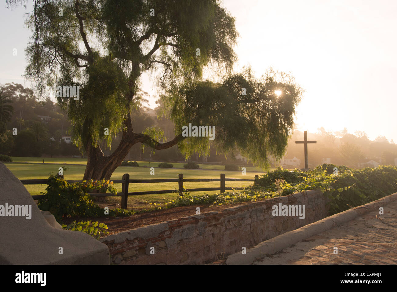 Cross on grounds of Mission Santa Barbara Queen of the Missions in Santa Barbara Central California USA - Stock Image