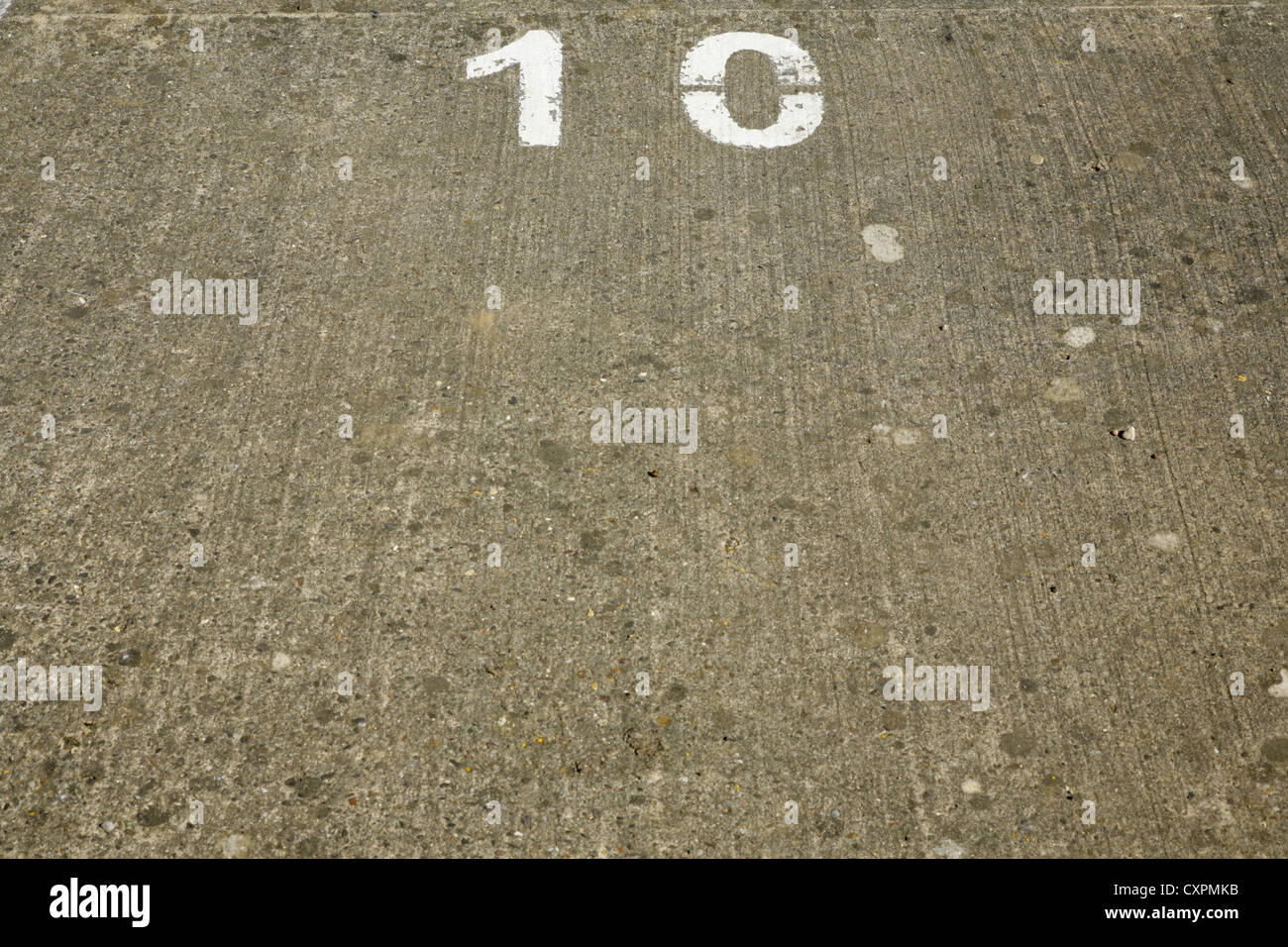Number 10 painted onto concrete surface - Stock Image