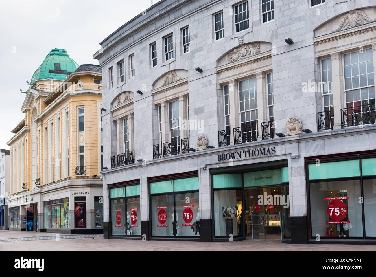 Department stores on St Patrick's Street, Cork City Centre, Republic of Ireland. - Stock Image