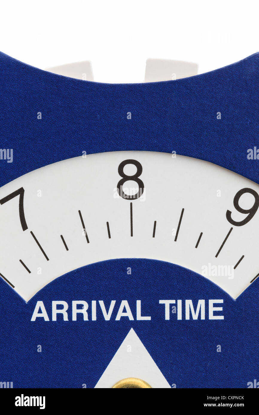UK cardboard parking disc arrival time indicator set at 8 o'clock in the morning - Stock Image