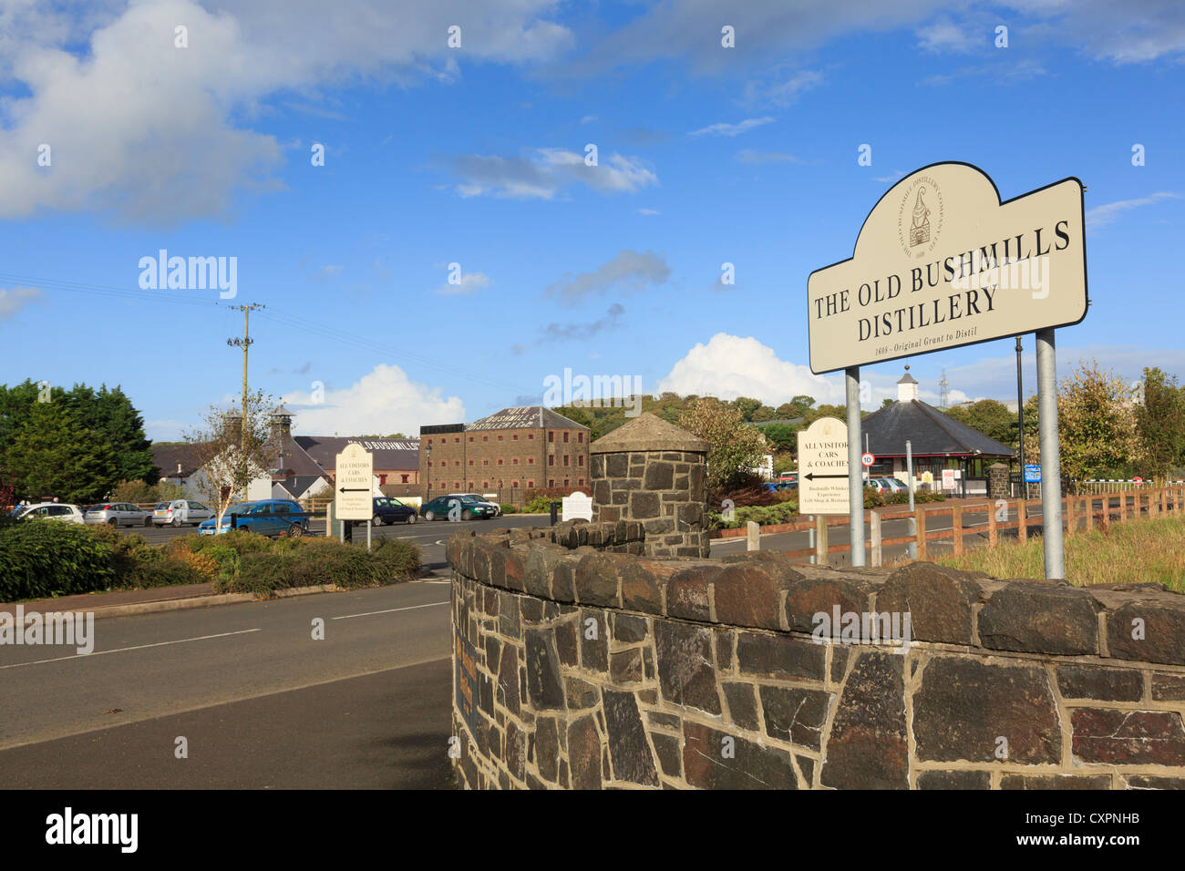 Sign at entrance to Old Bushmills Distillery Co Ltd distillers of Irish whiskey in Bushmills, Co Antrim, Northern - Stock Image