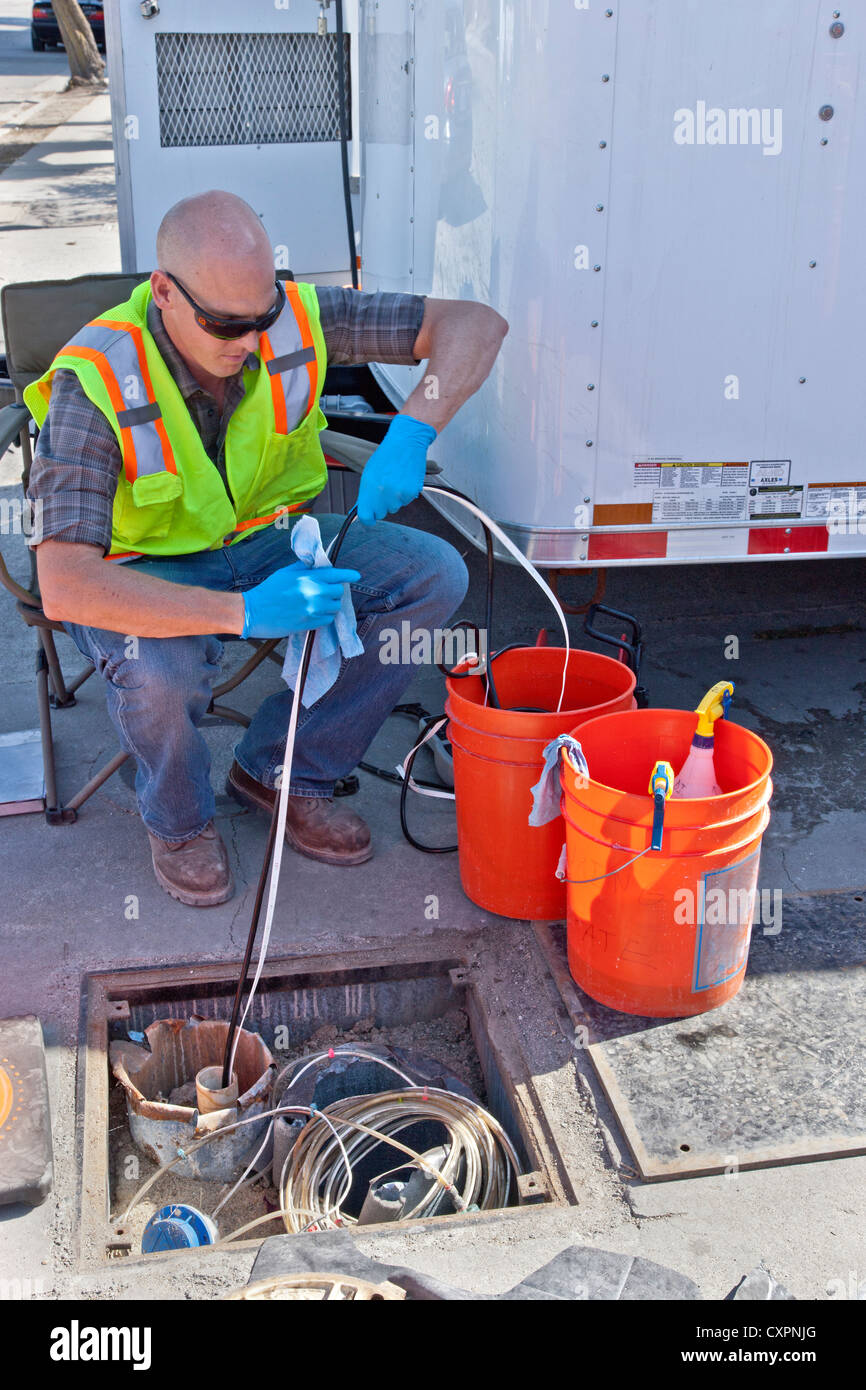 Technician preparing to test for groundwater contamination. - Stock Image